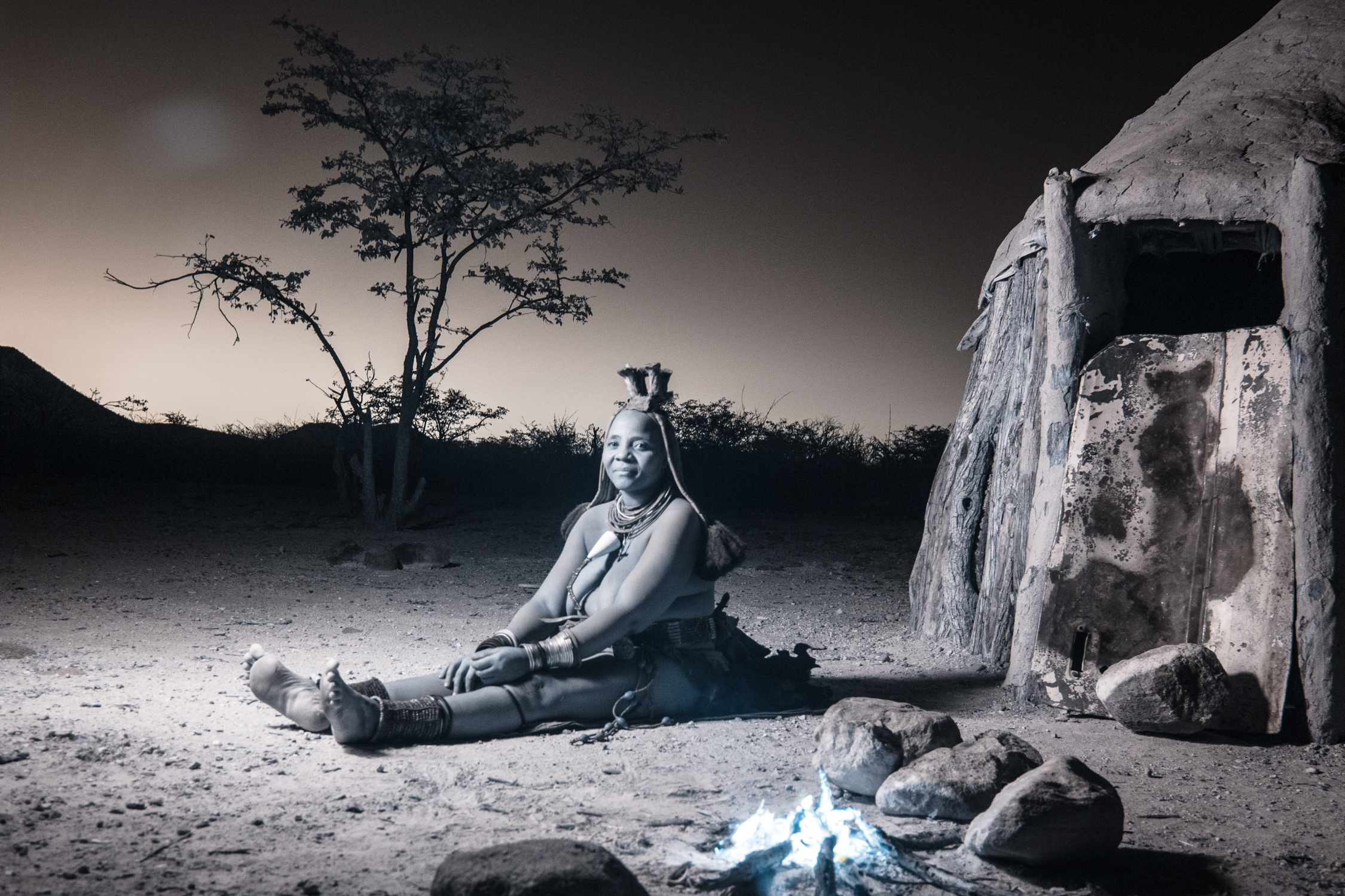 A Himba woman by firelight.