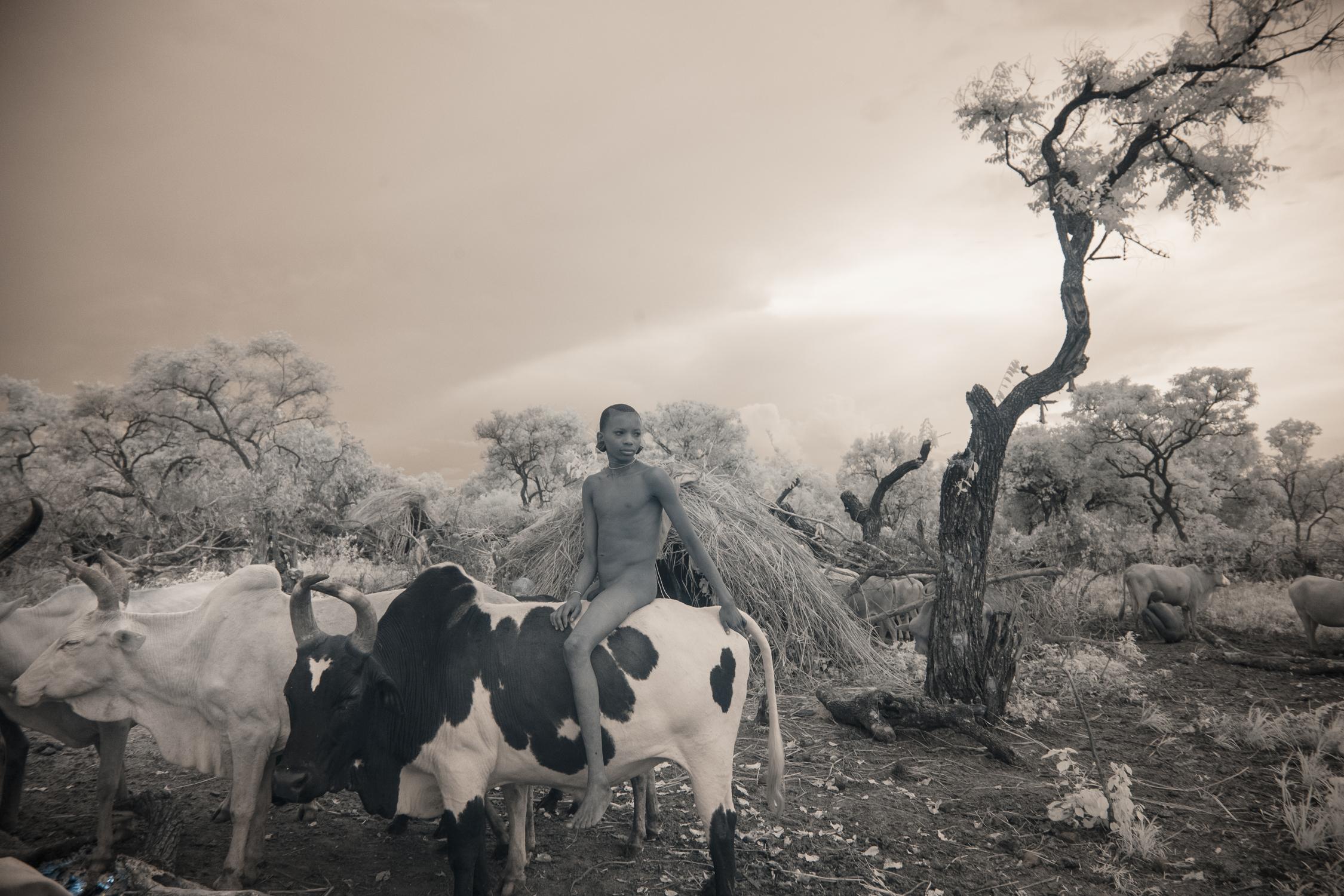 A Suri boy in the cattle camp.