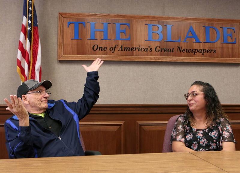 Two participants in the Bellwether Project at the Toledo Blade share their opposing political views as part of the project. Photo by Andy Morrison and courtesy of the Toledo Blade.