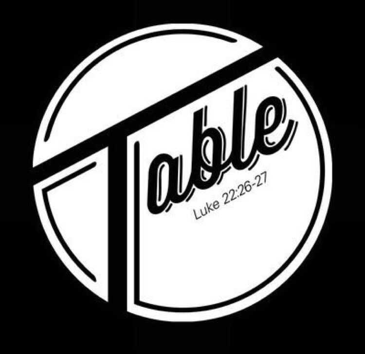 Table - At a dinner table, one can serve or be served food as the others engage in conversation. Thus,
