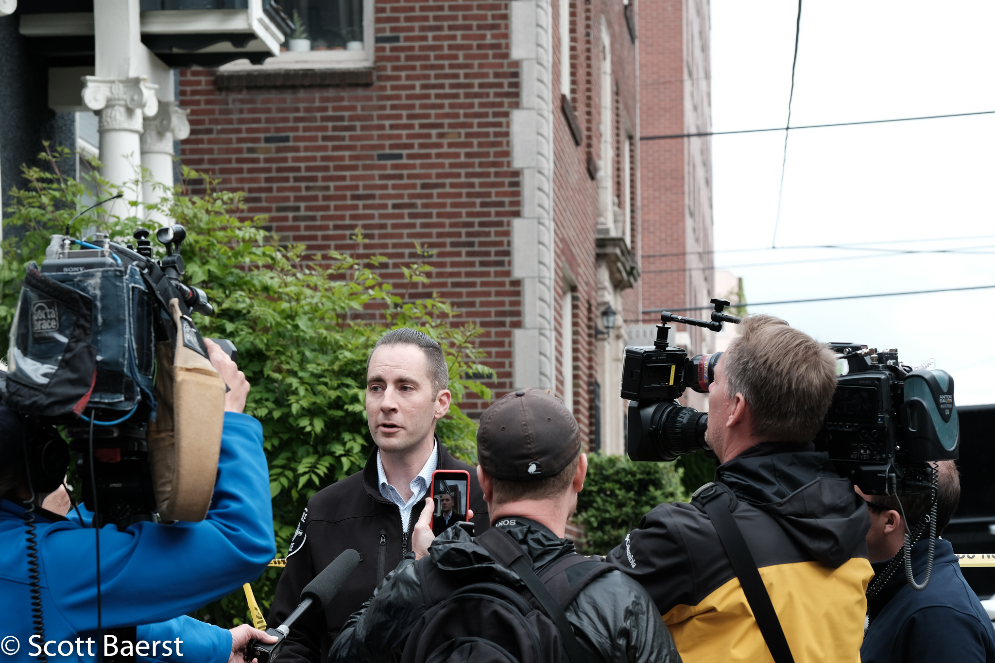 Seattle Police Department PIO Michaud briefs the press about the standoff with a suspect in a domestic violence incident on 30 May 2018, Capitol Hill, Seattle.