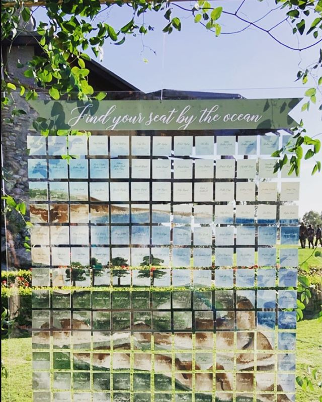 here's what happens when you take the invitation artwork and make it into 180 place cards and line them up on a 7 foot by 5 foot - 30lb piece of leucite and hang them from a metal frame covered in greenery ! @brightlydesigned thanks for making this idea come to life @splendidsentiments for making it happen. Always fun to come up with something different !