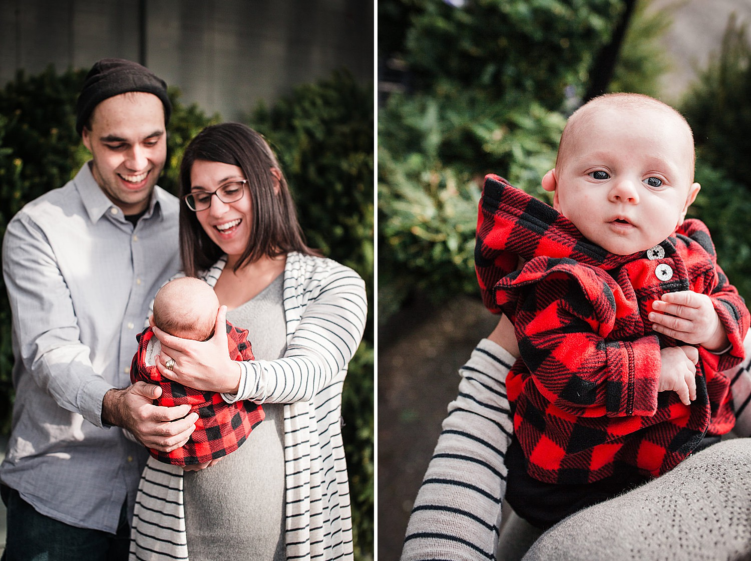Photo of a young couple holding their newborn baby girl in front of some greenery at Christmas time.