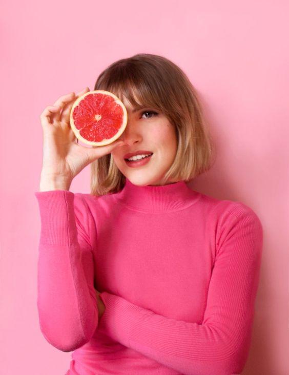 model with grapefruit.jpg