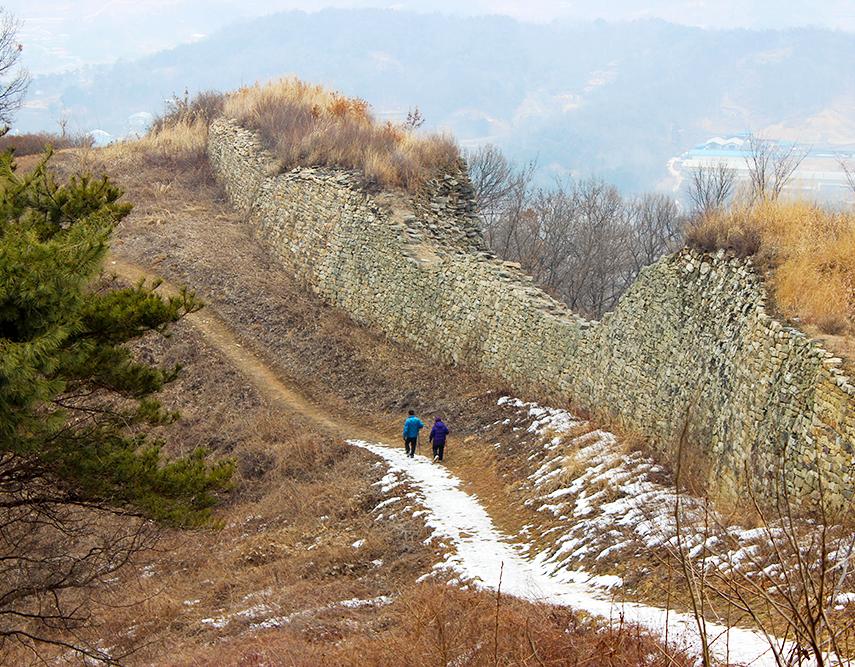 Walking along the wall