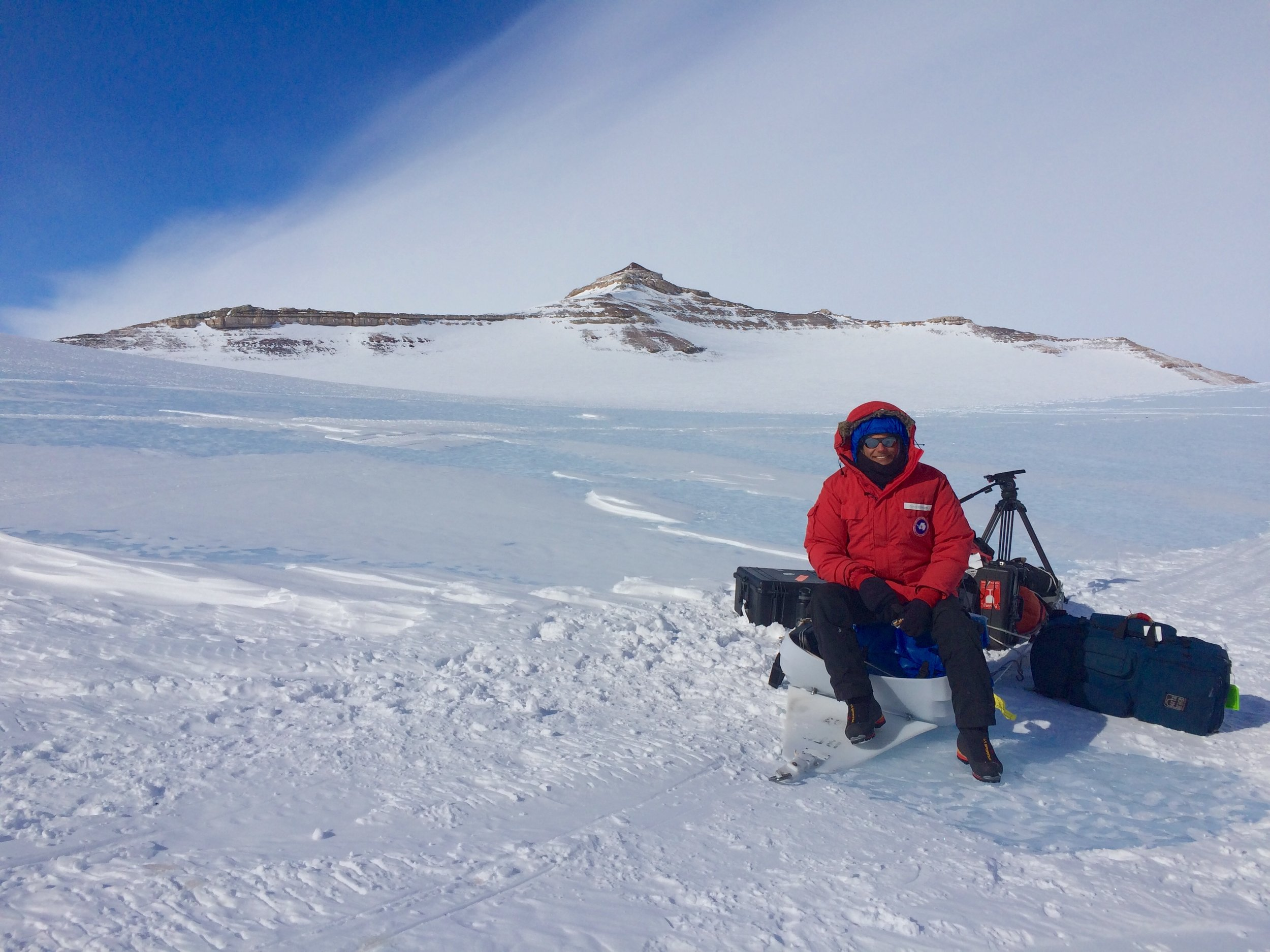 Waiting for a pickup on the snow machine in the remote Antarctic interior.