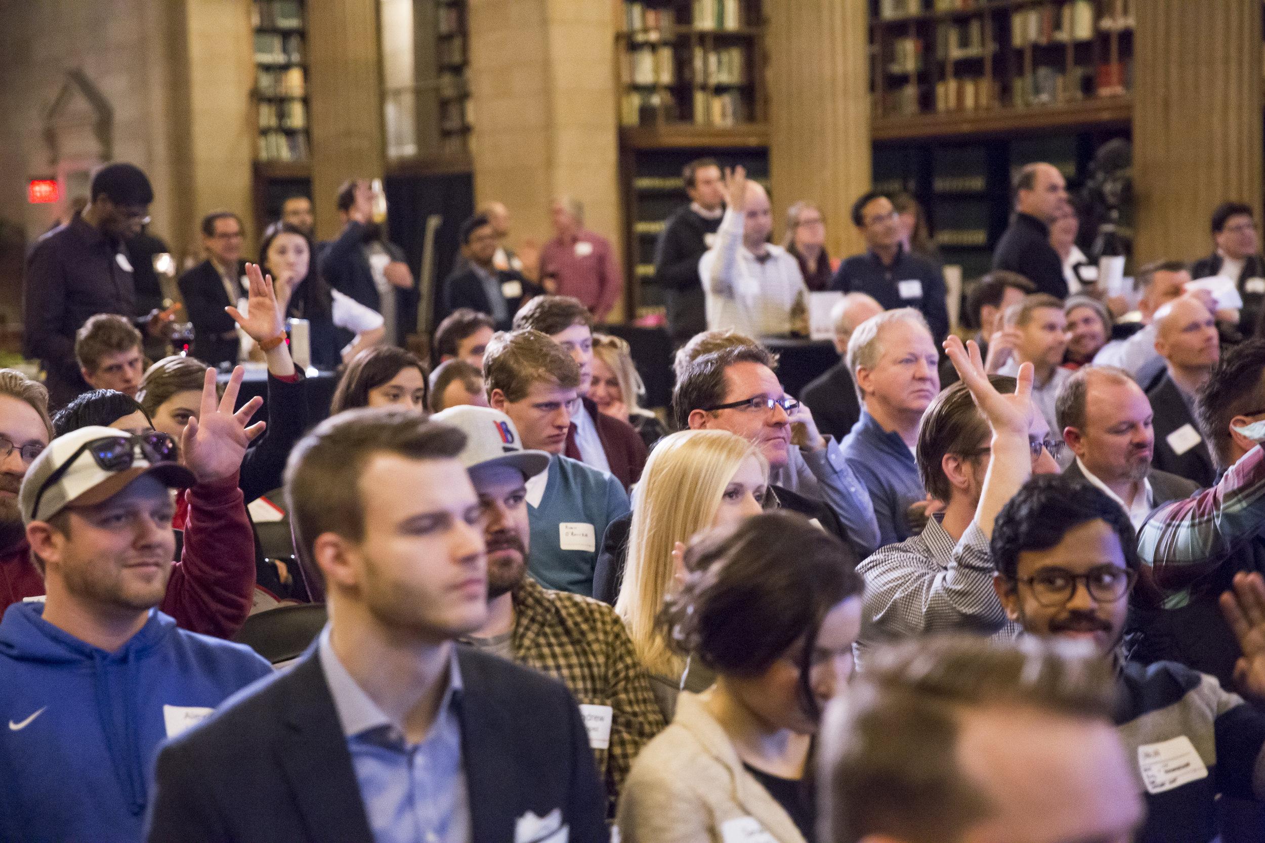 crowd raising hands.jpg