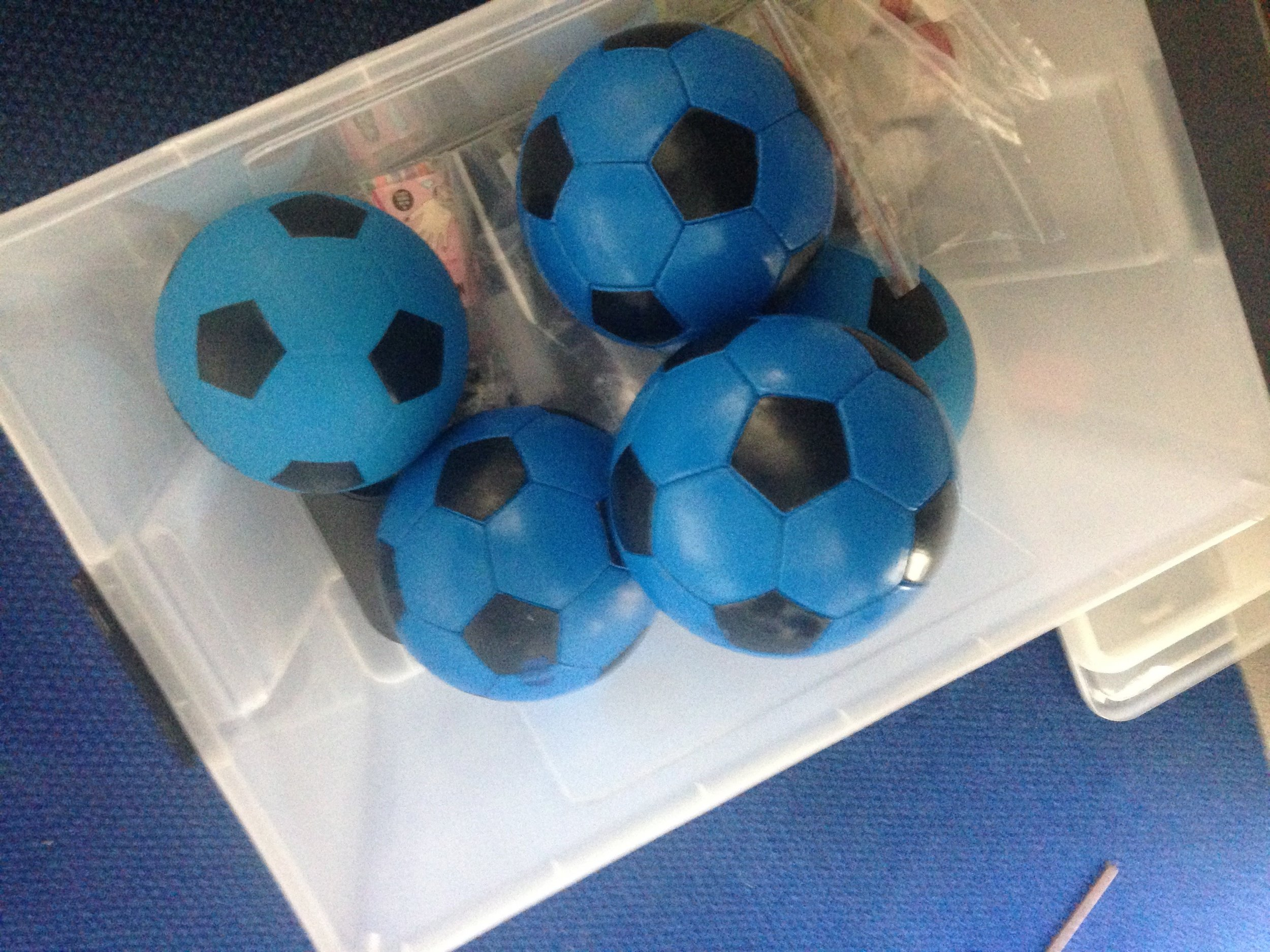 Soft and regular soccer balls that I painted