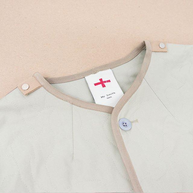 B21 Bomber Light jacket is detailed with press stud epaulettes on each shoulder.jpg