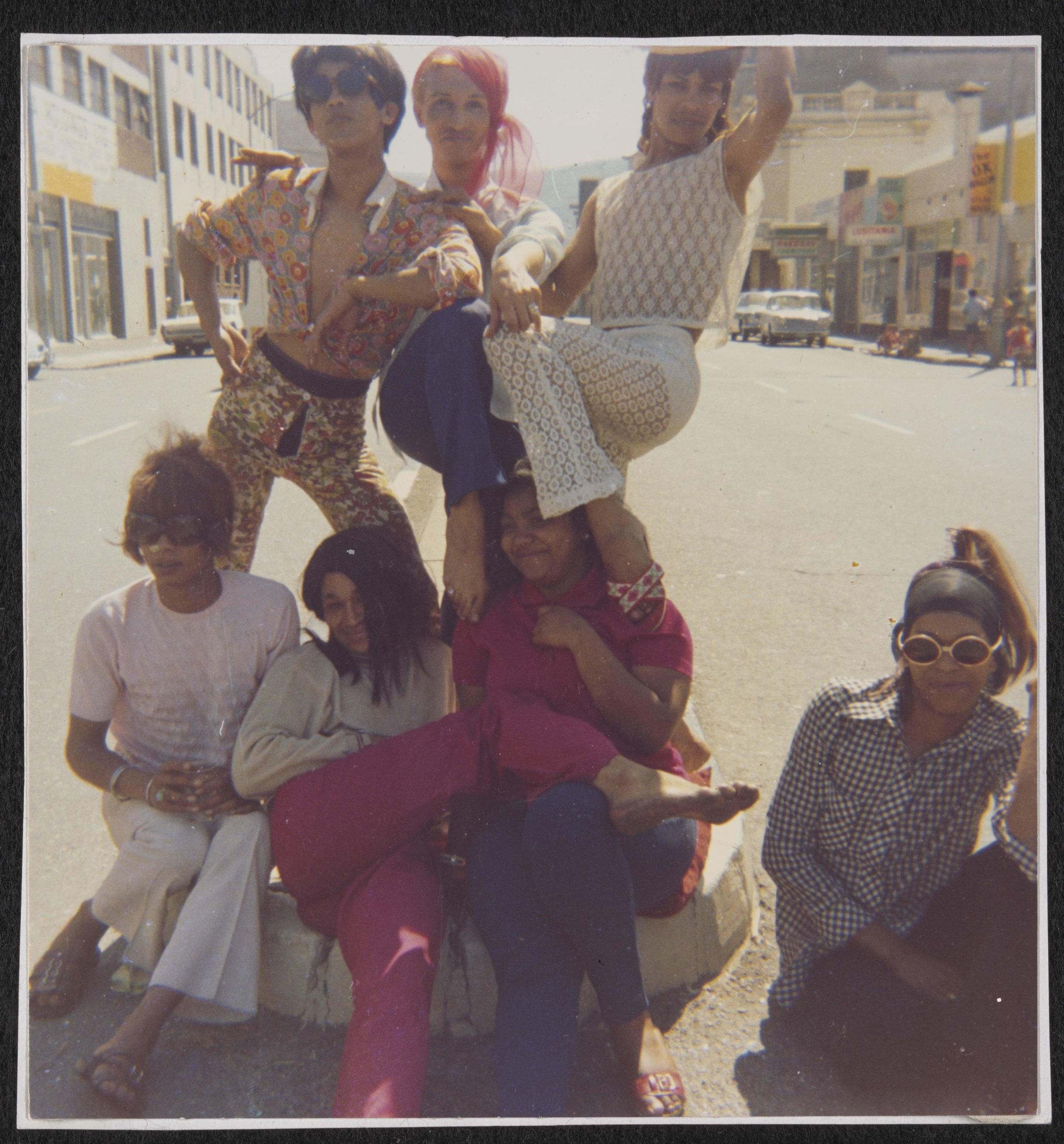 Olivia, Kewpie, Patti, Sue Thompson, Brigitte, Gaya, and Mitzy in the Middle of the Street