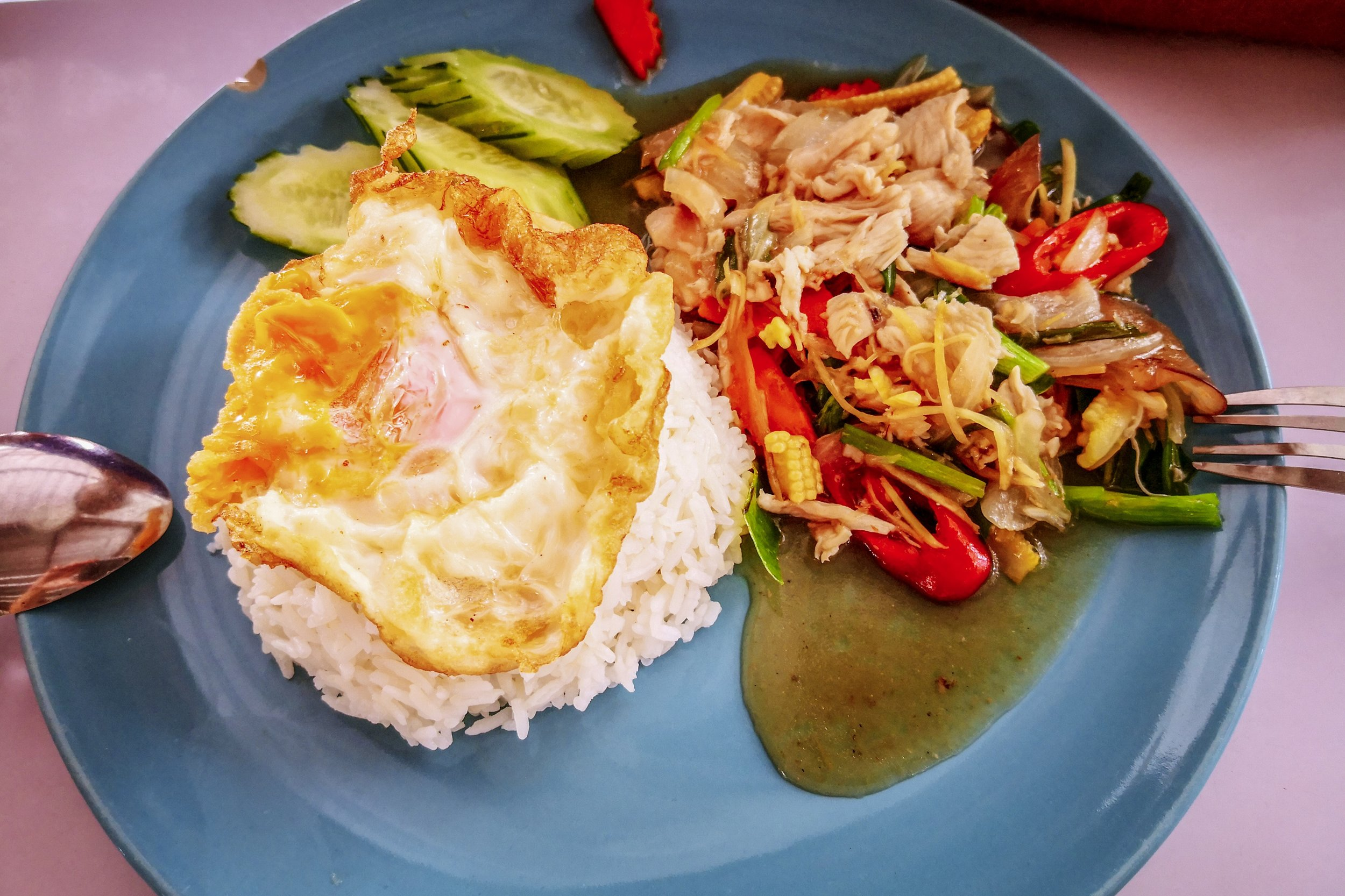 Stir-fried chicken with ginger and vegetables, rice with egg on top