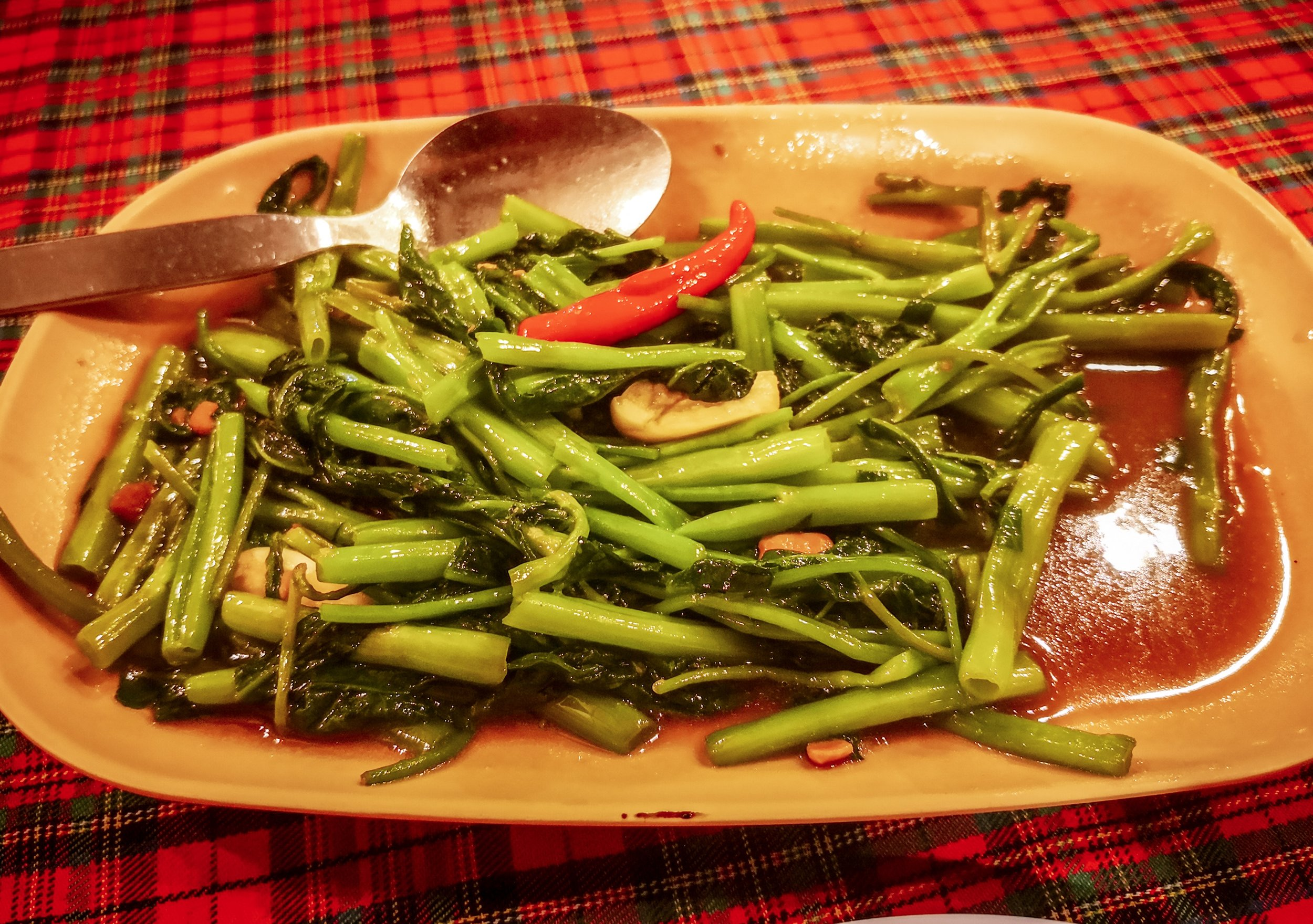 Stir-fired morning glory in oyster sauce - sounds funny, but it's a vegetable what is worth its name