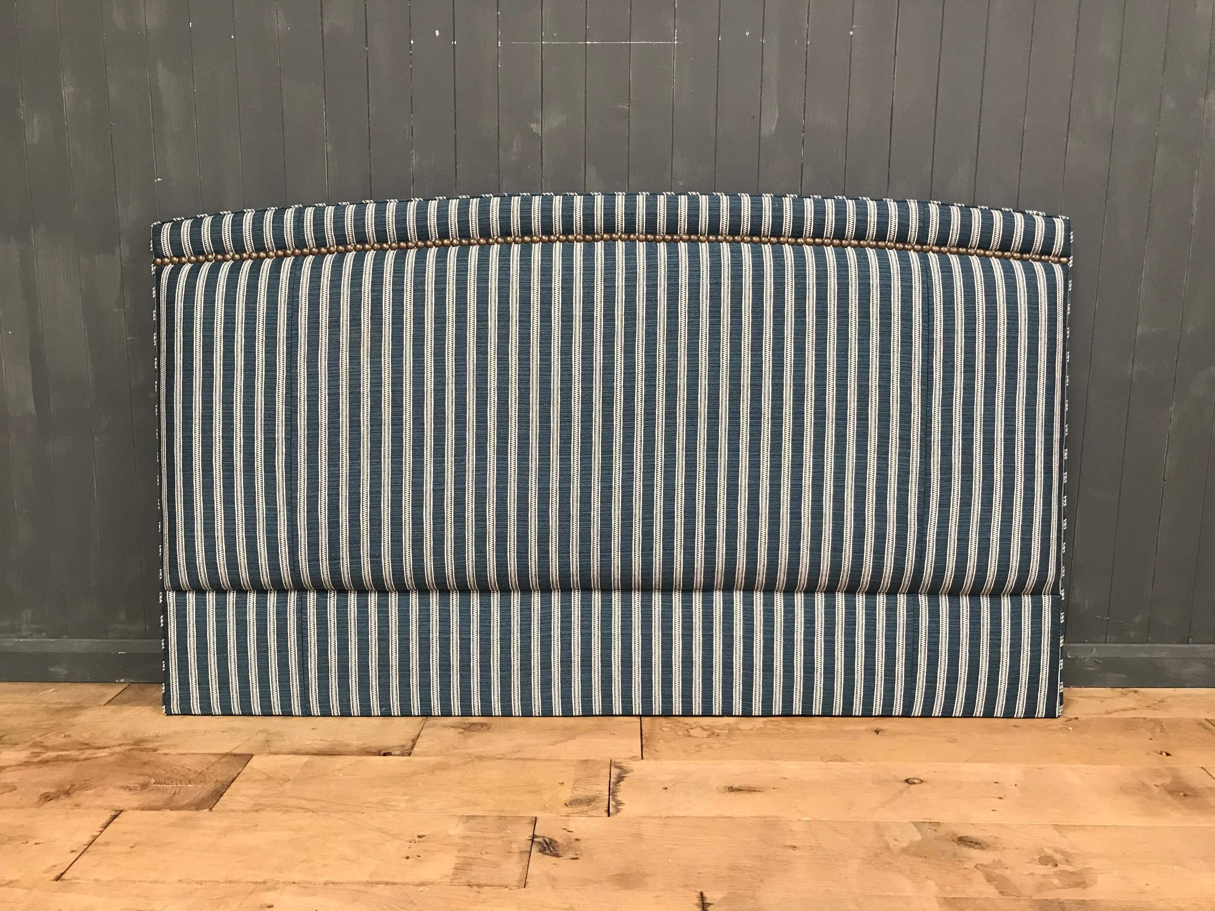 Bespoke Upholstered Headboard, slightly curved with studded border to top edge only