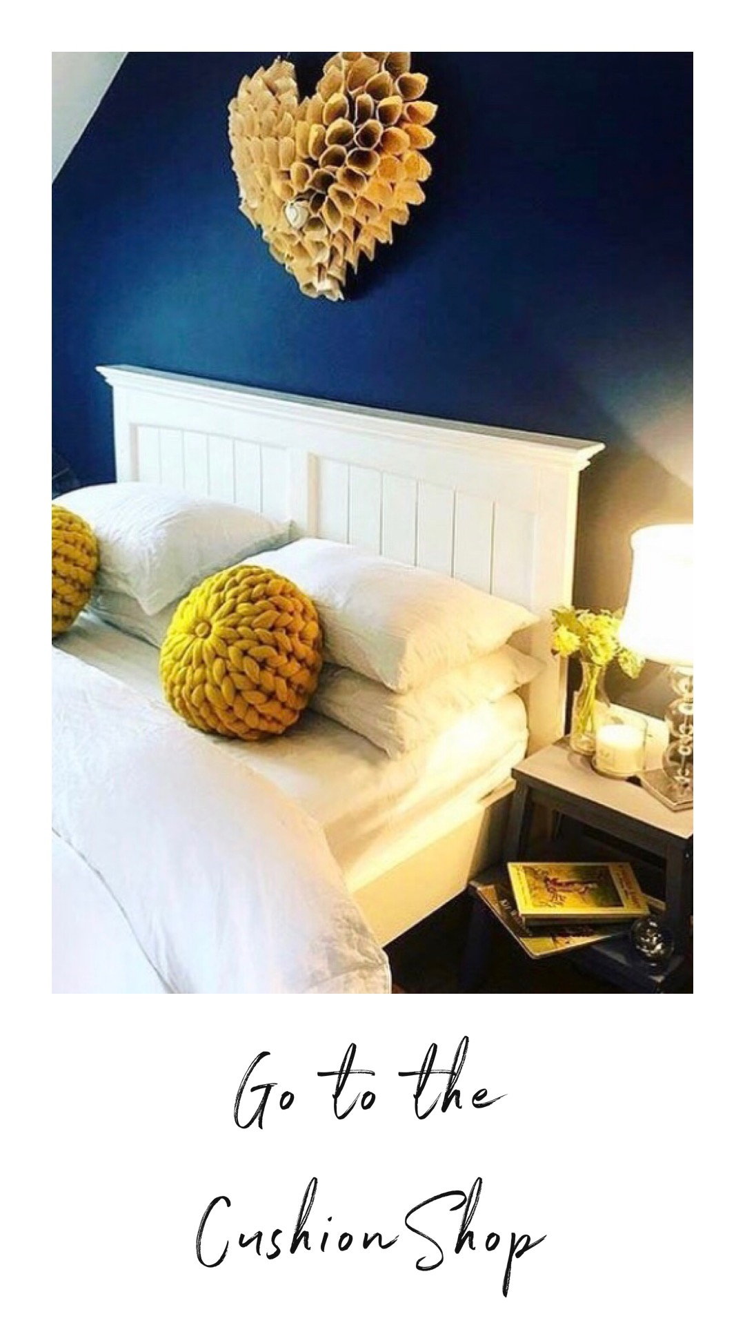 two yellow chunky knit round cushions on bed