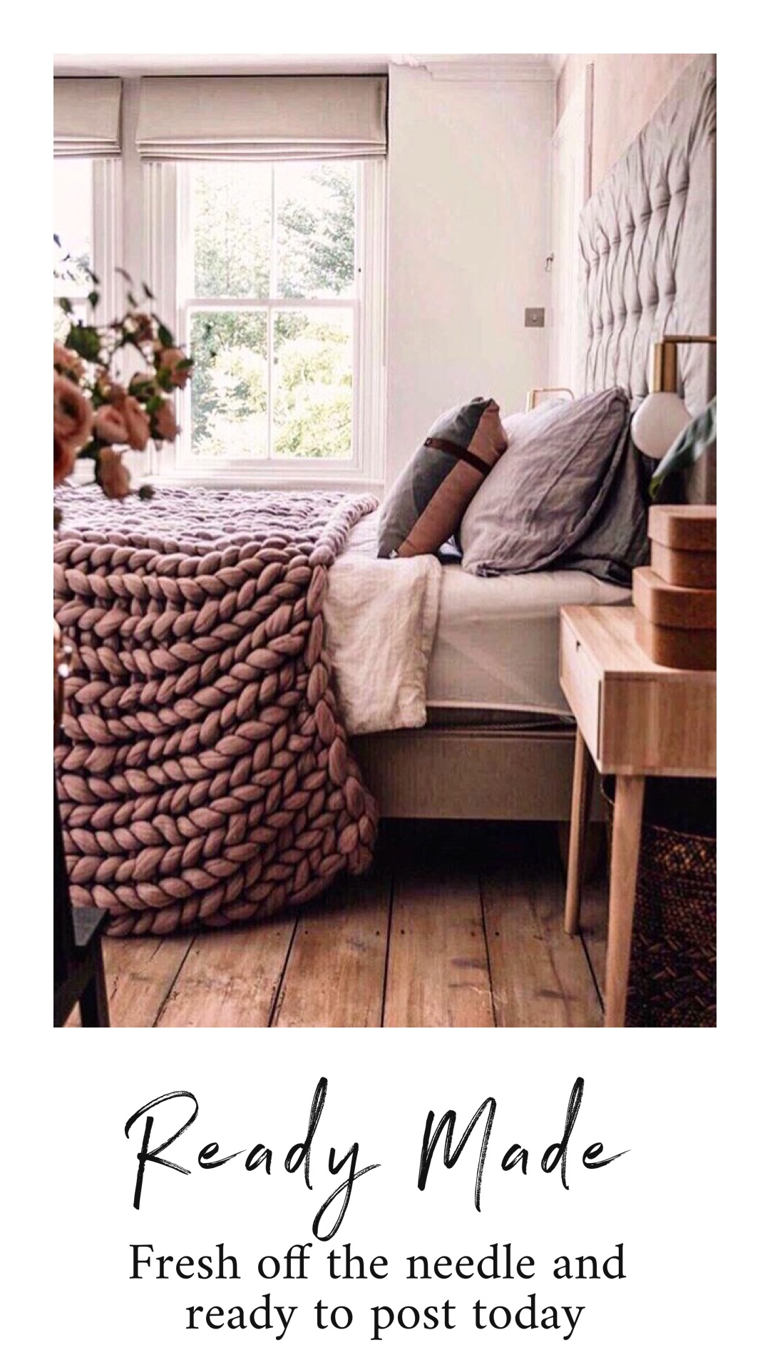 pink chunky knit blanket in bedroom
