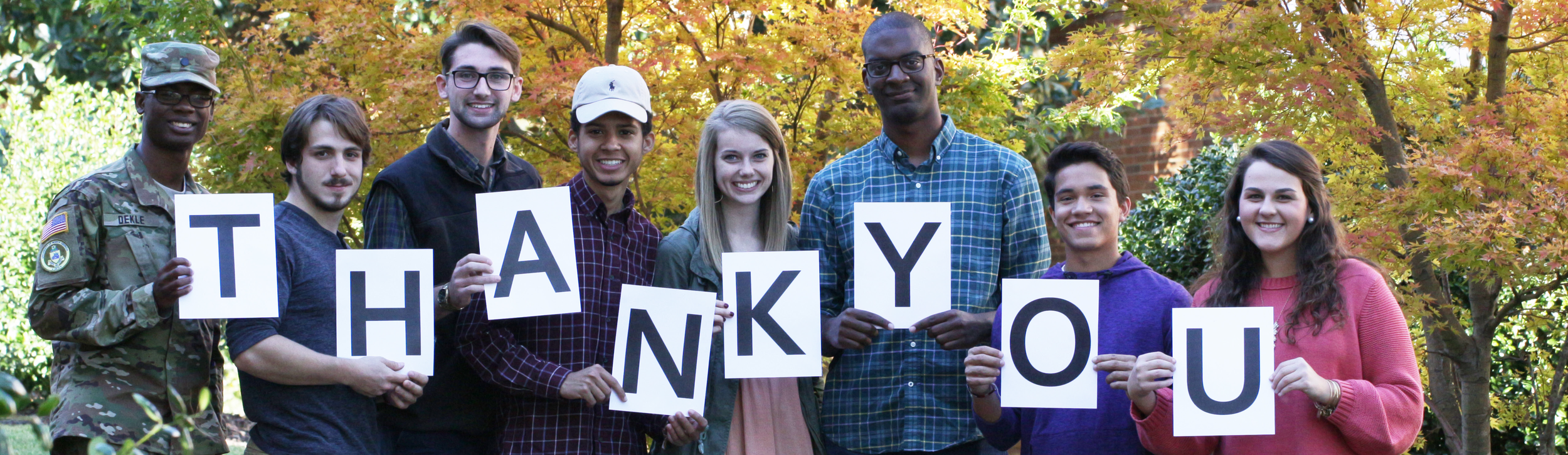 Thank you page banner features students holding up letters to spell out the words 'thank you'.