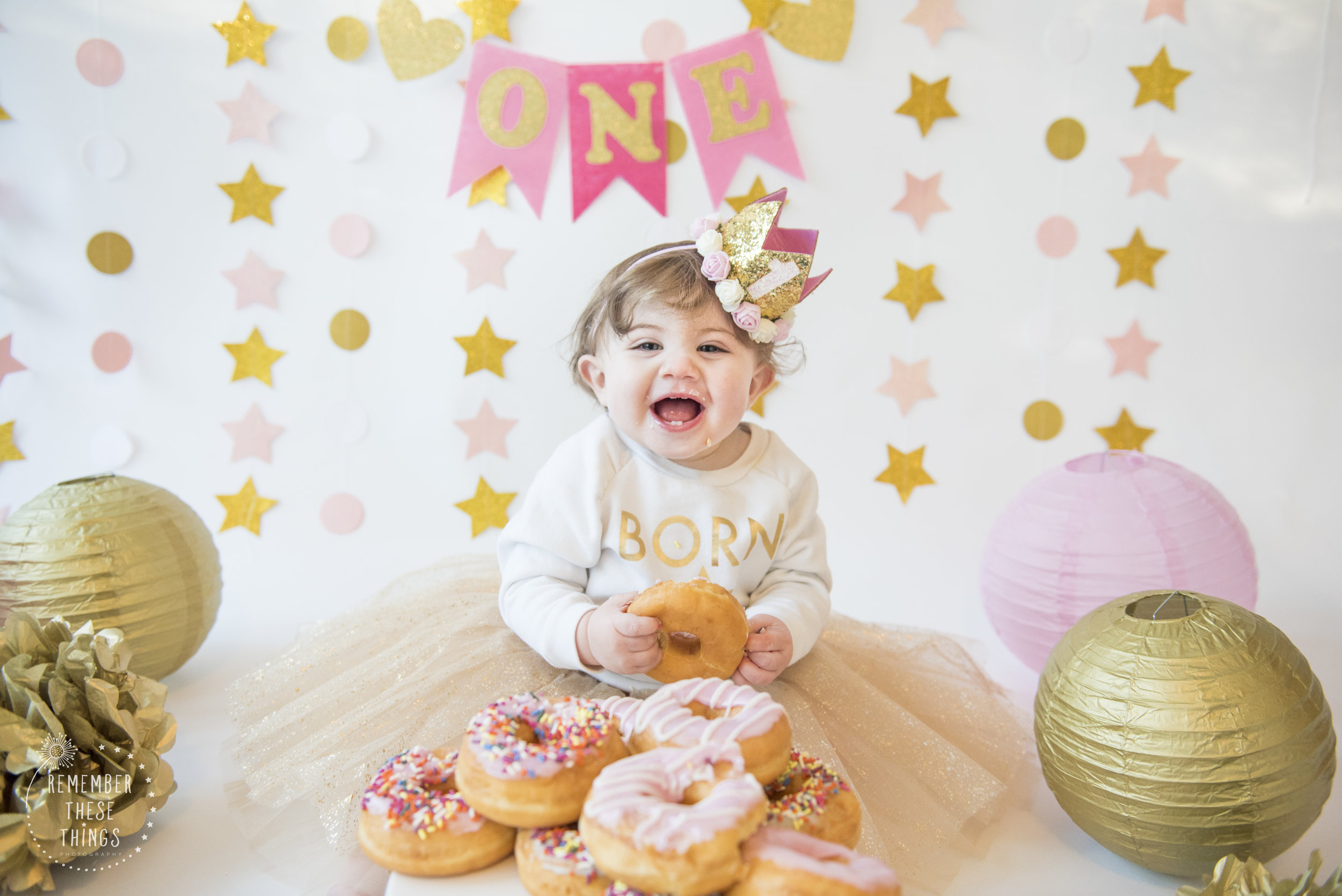 one year old, doughnuts, tiny teeth and smiles!