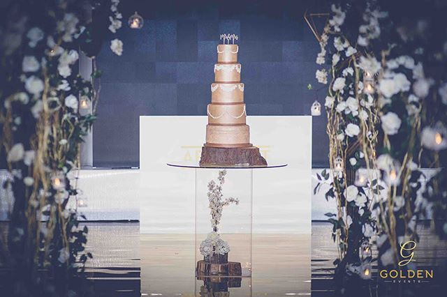 The cake is always an attraction at a wedding.  How stunning does the cake look with our floating table and floral arches from the walkway against the golden dance floor 😍  Luxury Marquees | Bespoke Event Decor  M : 077 020 63 290 ‭T :  0121 312 5333‬ E : info@goldenevent.co.uk W: www.goldenevent.co.uk #goldenevents  #love  #likeforlikes  #designer  #luxury  #followforfollowback  #follow4followback  #asianwedding  #indianwedding  #englishwedding #idea #weddingidea  #details  #settings #decoration  #flowers  #floral  #roses  #familytables  #asianweddings  #beautiful  #photooftheday  #picoftheday  #follow #style  #amazing  #instapic #inspiration #birmingham  #weddingreception