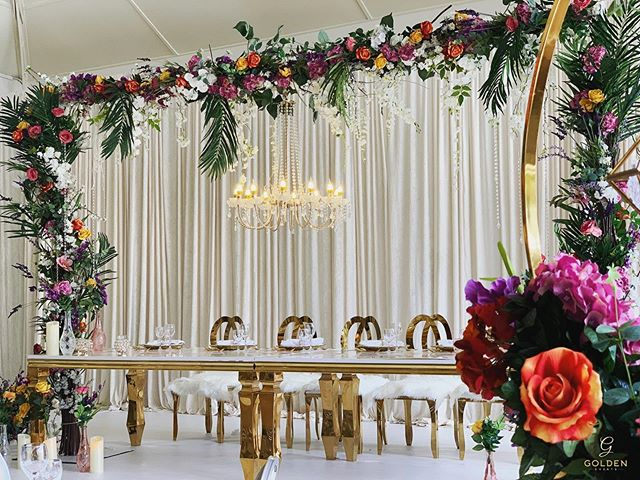 T R O P I C A L - F A M I L Y -T A B L E  In love with this tropical family table setting, complete with a suspended chandelier 🌸🌿❤️ Luxury Marquees | Bespoke Event Decor  M : 077 020 63 290 T :  0121 312 5333 E : info@goldenevent.co.uk W: www.goldenevent.co.uk #goldenevents  #love  #likeforlikes  #designer  #luxury  #followforfollowback  #follow4followback  #asianwedding  #indianwedding  #englishwedding #idea #weddingidea  #details  #settings #decoration  #flowers  #floral  #roses  #familytables  #asianweddings  #beautiful  #photooftheday  #picoftheday  #follow #style  #amazing  #instapic #inspiration #birmingham  #weddingreception