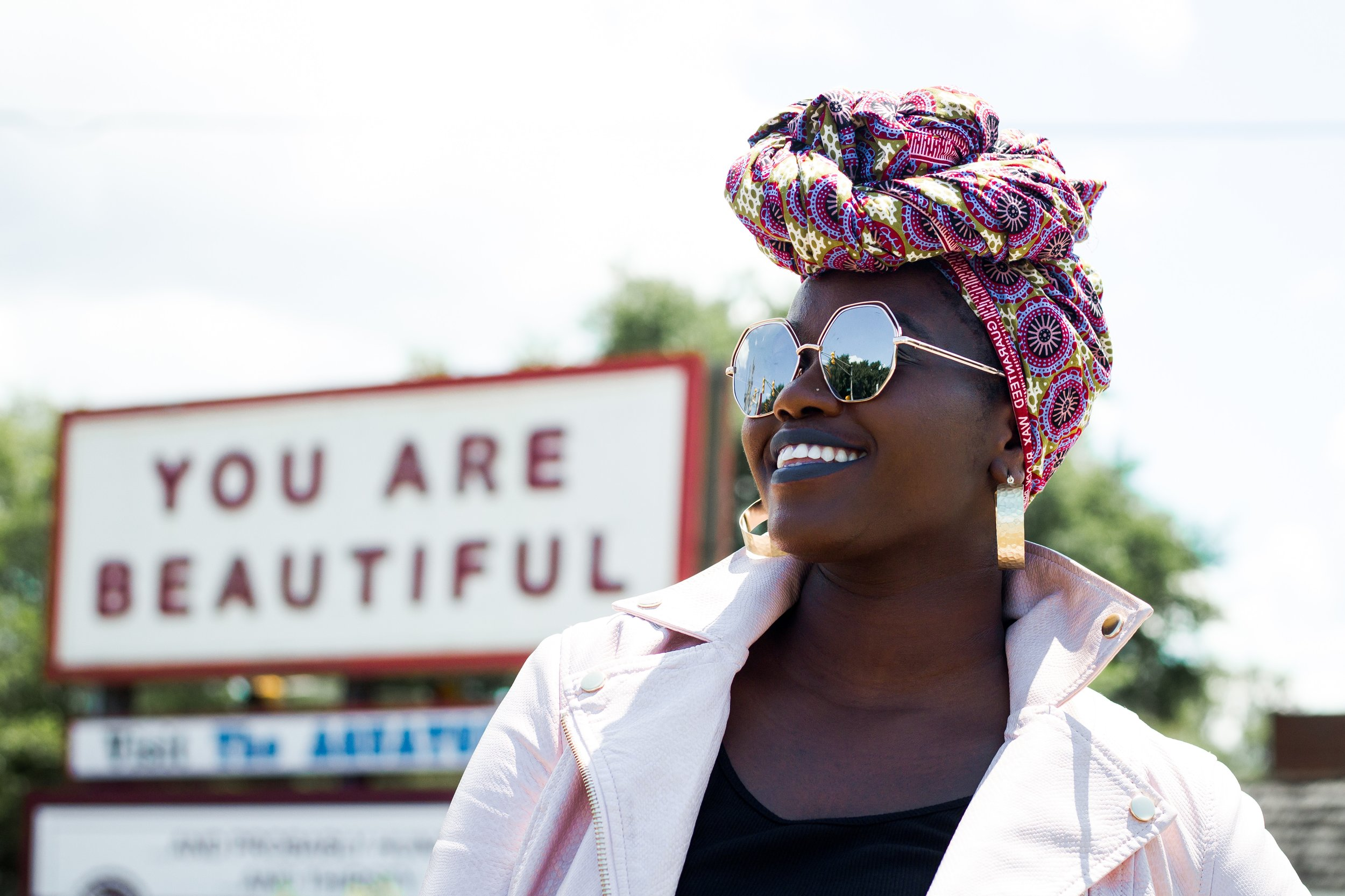 women smiling in front of you are beautiful sign.jpg