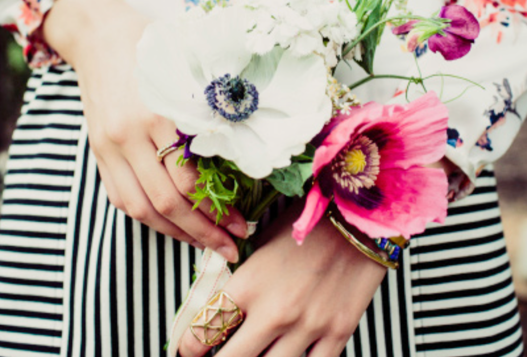 woman holding flowers.png