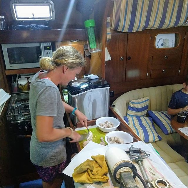 Boat life: food prep and mechanical work often happen in the same space.