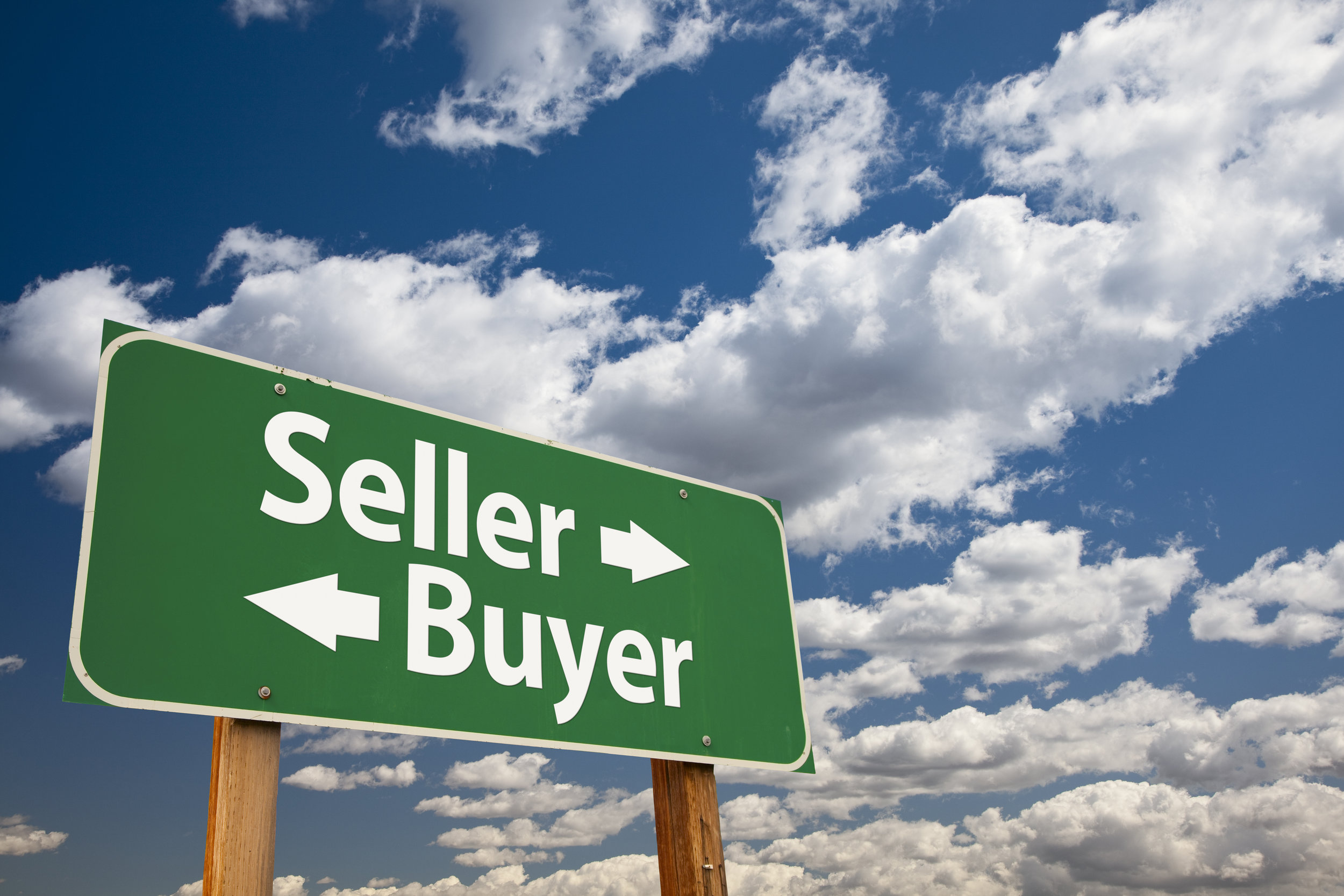 Seller, Buyer Green Road Sign Over Clouds