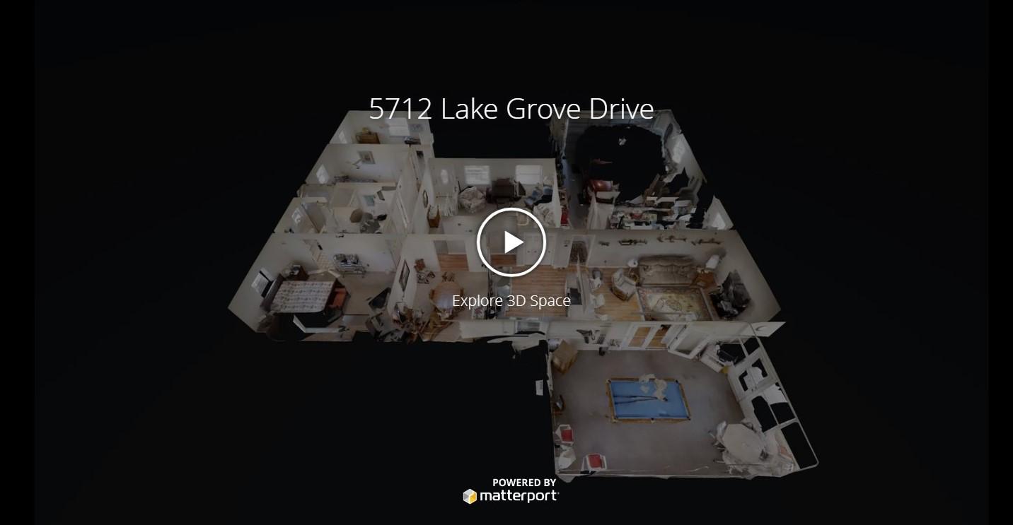 5712 Lake Grove Drive - Beautiful Canal Home!