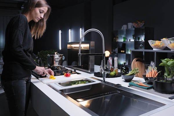 FRANKE Franke has been an industry leader in kitchen products for years. They're Chef Center Sink was love at first sight - clean modern lines incorporated with organized smart design. Such as, compartments for both compost and cleaning supplies as well as accessories like a roll up drying rack, a drop-in drain board, and a glass cutting board. By far the coolest sink I've ever seen.   Learn more here