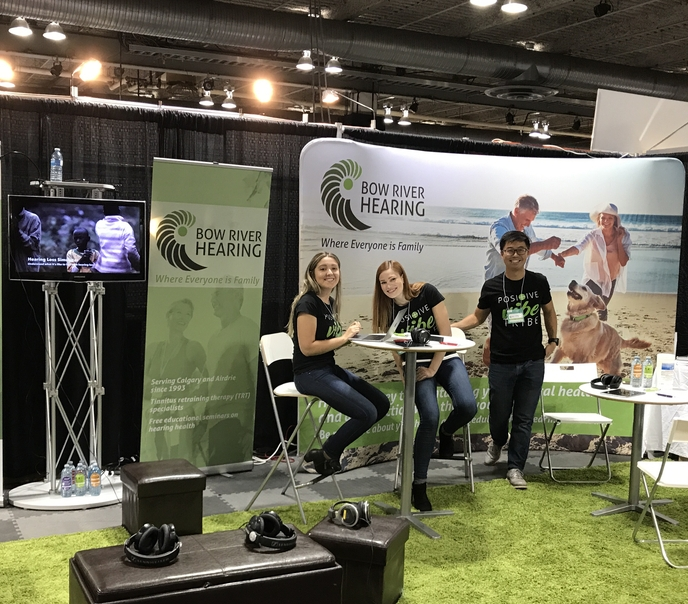 Lacey, Brooke, and Jon giving out FREE hearing tests at the Calgary Fall Home Show.