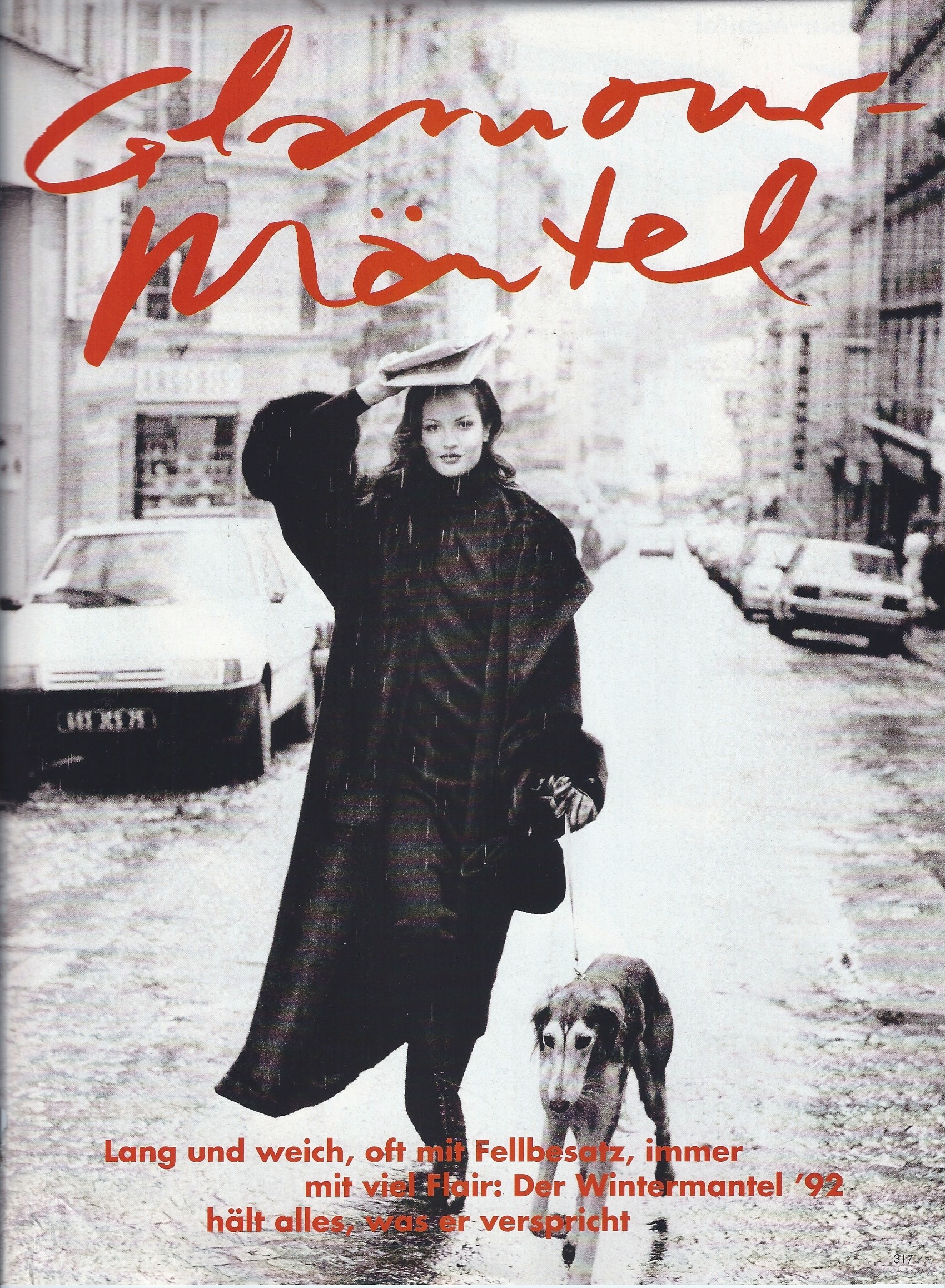 Me in Paris with a dog enjoying the rain for German Vogue shot by Pamela Hanson. Talk about backdrop setting the mood for a shoot!