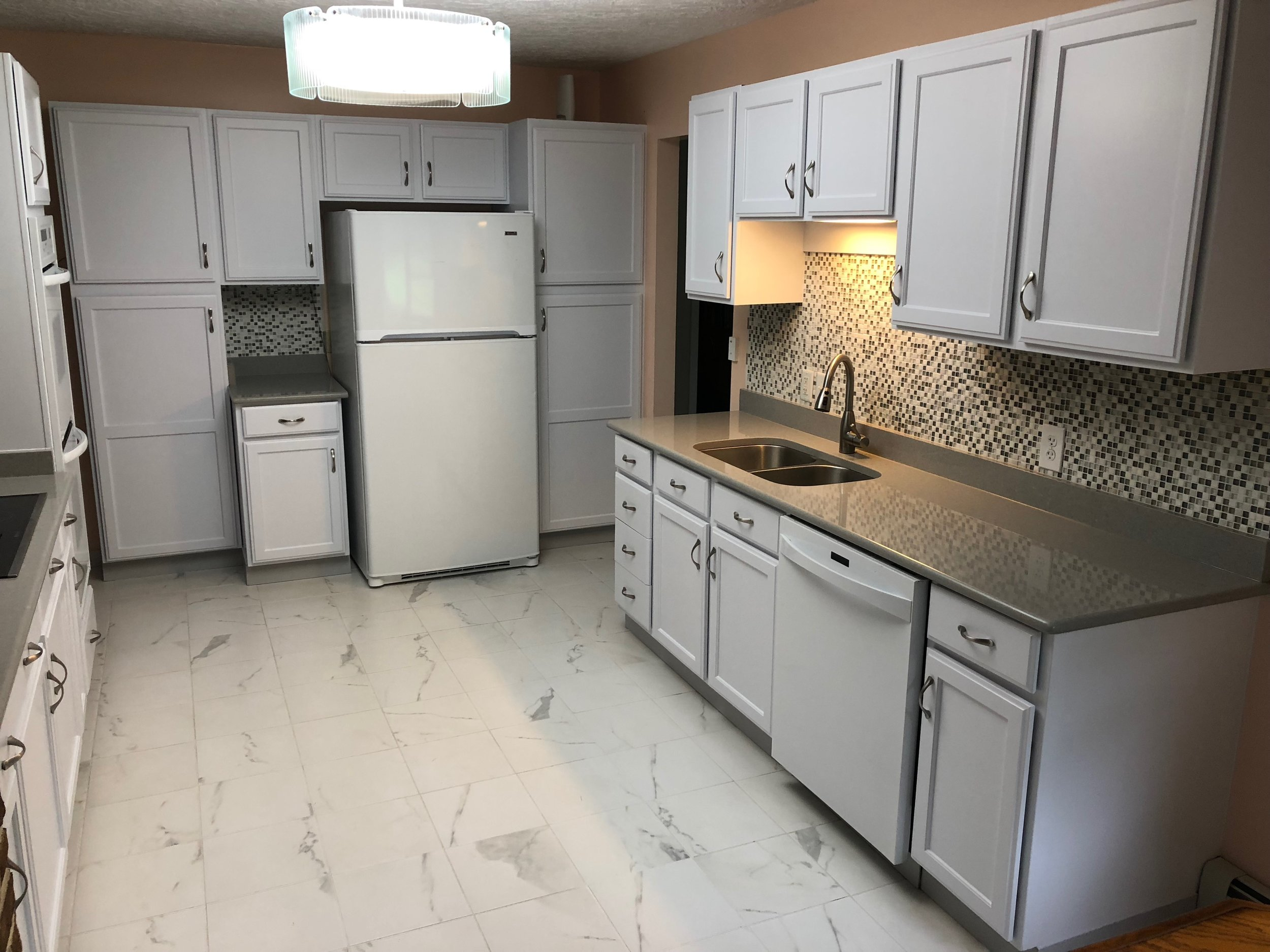 After - Kitchen Cabinets Painted off white