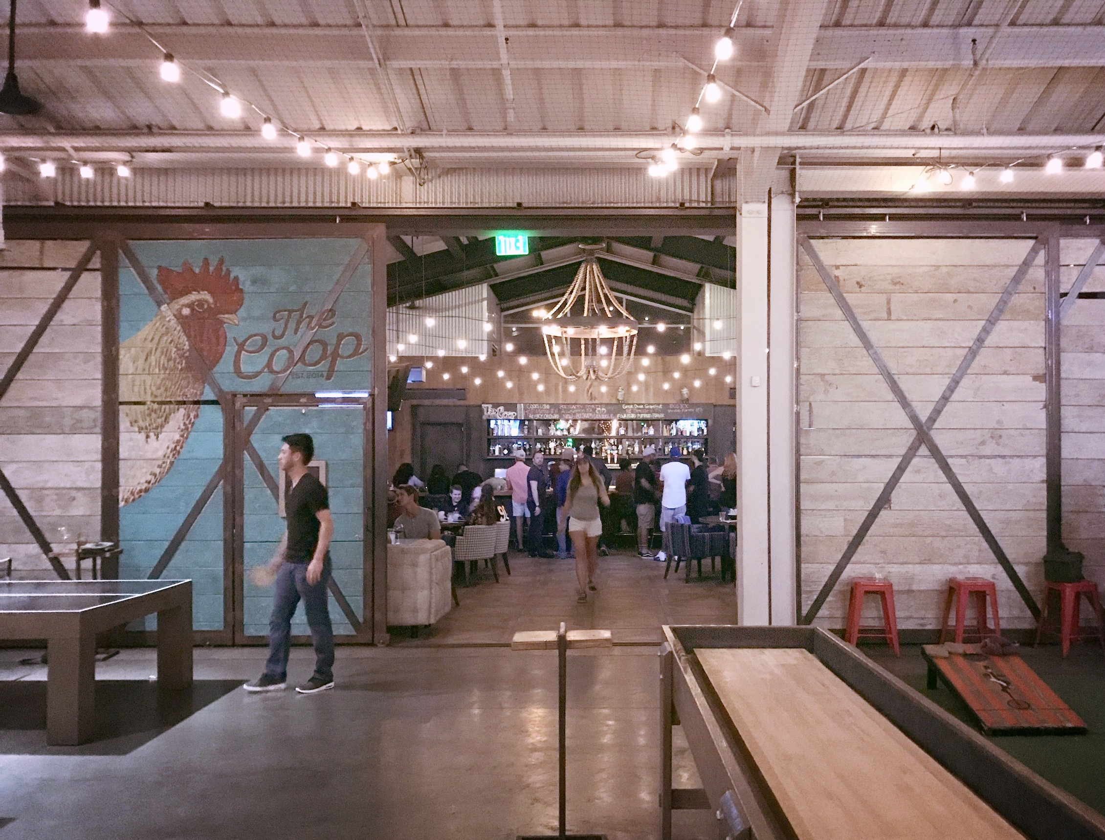 The Yard  // Culinary Dropout in Tempe. Pictured: view from shuffle board table, bags court to the right, ping pong tables to the left, full bar ahead