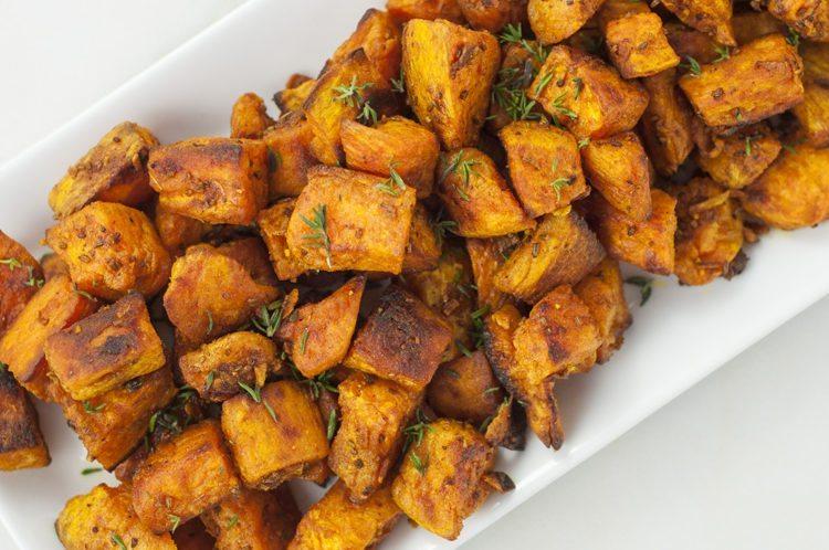 Skinny Ms'Turmeric Roasted Sweet potatoes - Serve with roasted salmon (left)