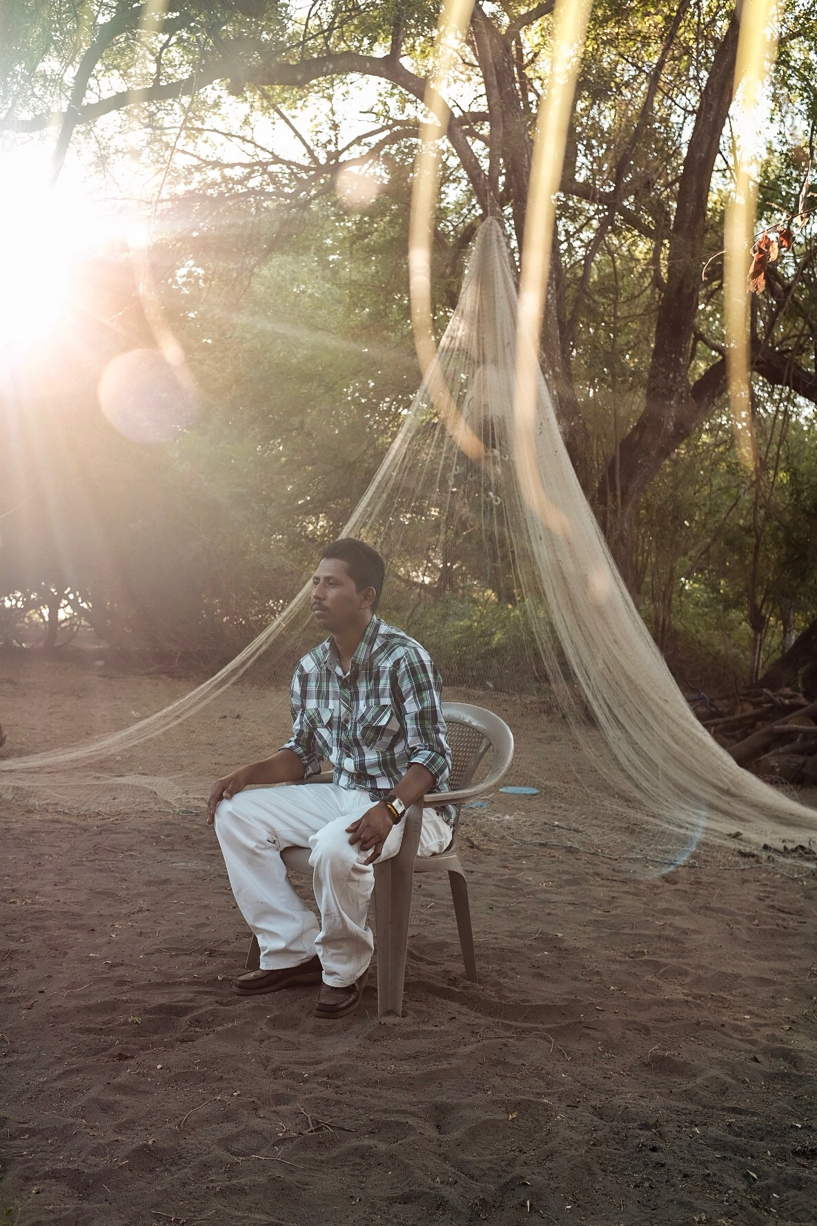 The Fisherman - On weekdays, he mends nets and makes dynamite by hand. On weekends, he joins the community as a pastor.