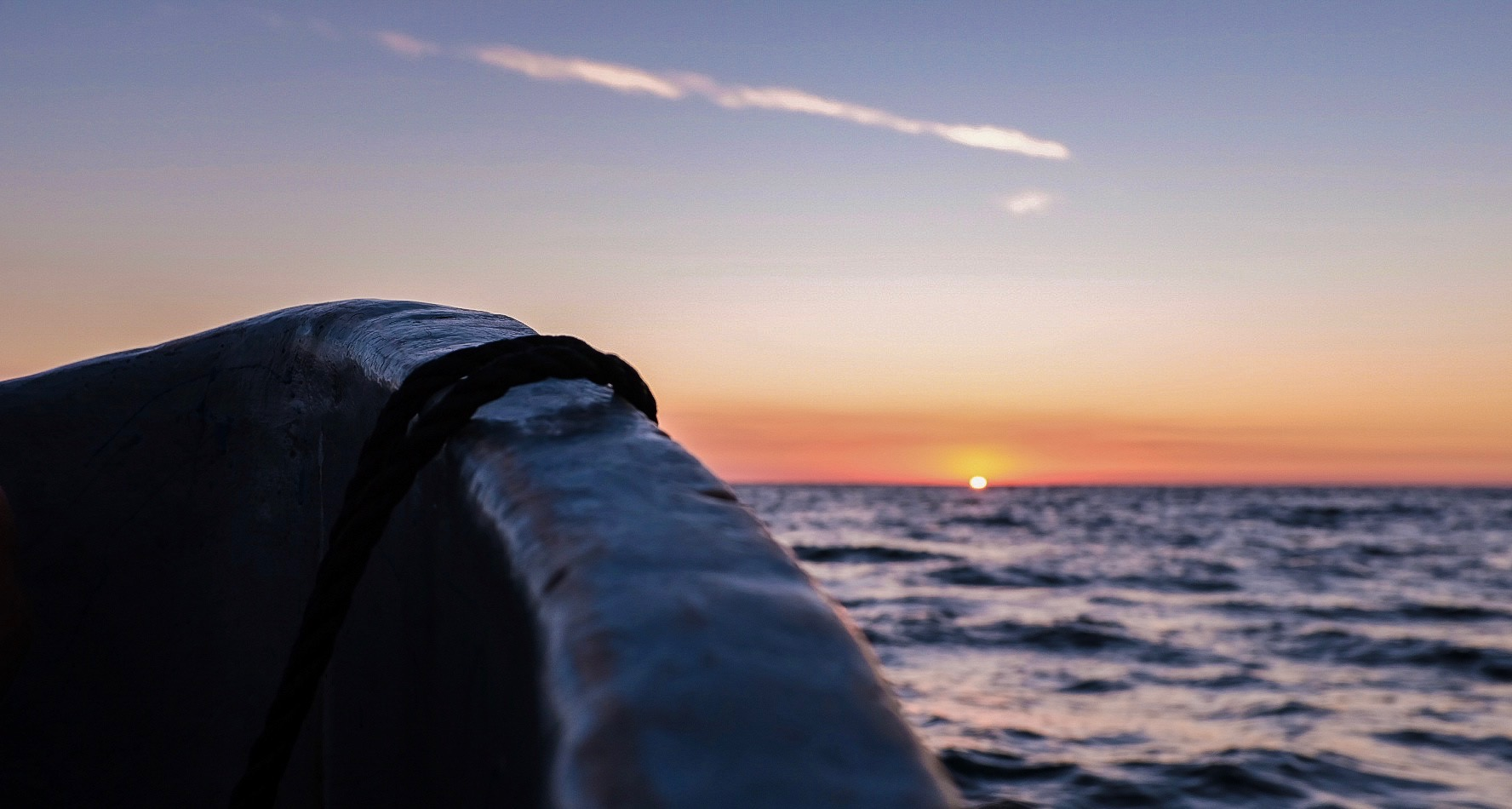 The setting sun, marking the start to a long night out at sea.