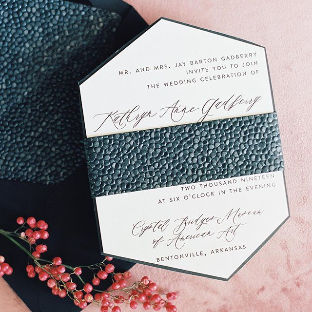 this suite you guys 😍 it was definitely a labor of love! suite details: i created this shape from scratch, sourced the pebble paper, cut it into the liner and belly band, put the liner in, attached the belly band, we had black inner envelopes with white ink for the guest names, the rsvp was the same shape, we had another insert card as well, both invitation and rsvp were mounted on black stock that was cut into the same shape and everything went in an outer envelope. i can't even count up how many days this took because it was probably the longest production i've ever had but everything was totally with it! ❤️❤️ . . photographer: @erinwilsonphoto  planning: @natashamgates @anneclaireallen  florals: @zuzuspetalsandgifts  venue: @crystalbridgesmuseum . .  #custompapergoods #invitations #weddinginvitations #shoppapersupplyco #custominvitations #papergoods #prettypaperie #makemoments #weddinginvites #handlettering #arkansaswedding #arkansasbride #arbride #weddingsinarkansas #weddingdetails #flatlay #stylemepretty #bridetobe #theknot #dailydoseofpaper #papergoods #weddinginspo #stationerylove #moderninvitation