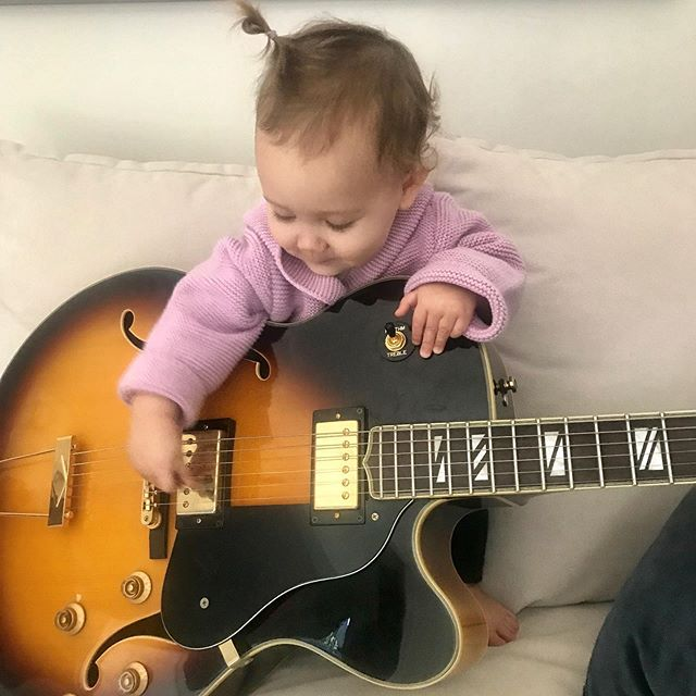 Here's to hoping Norah learns to like Daddy's music more than Mommy's music... 😜 She is even playing with a pick... which she later kept putting in her mouth😒  @kristylmarshall