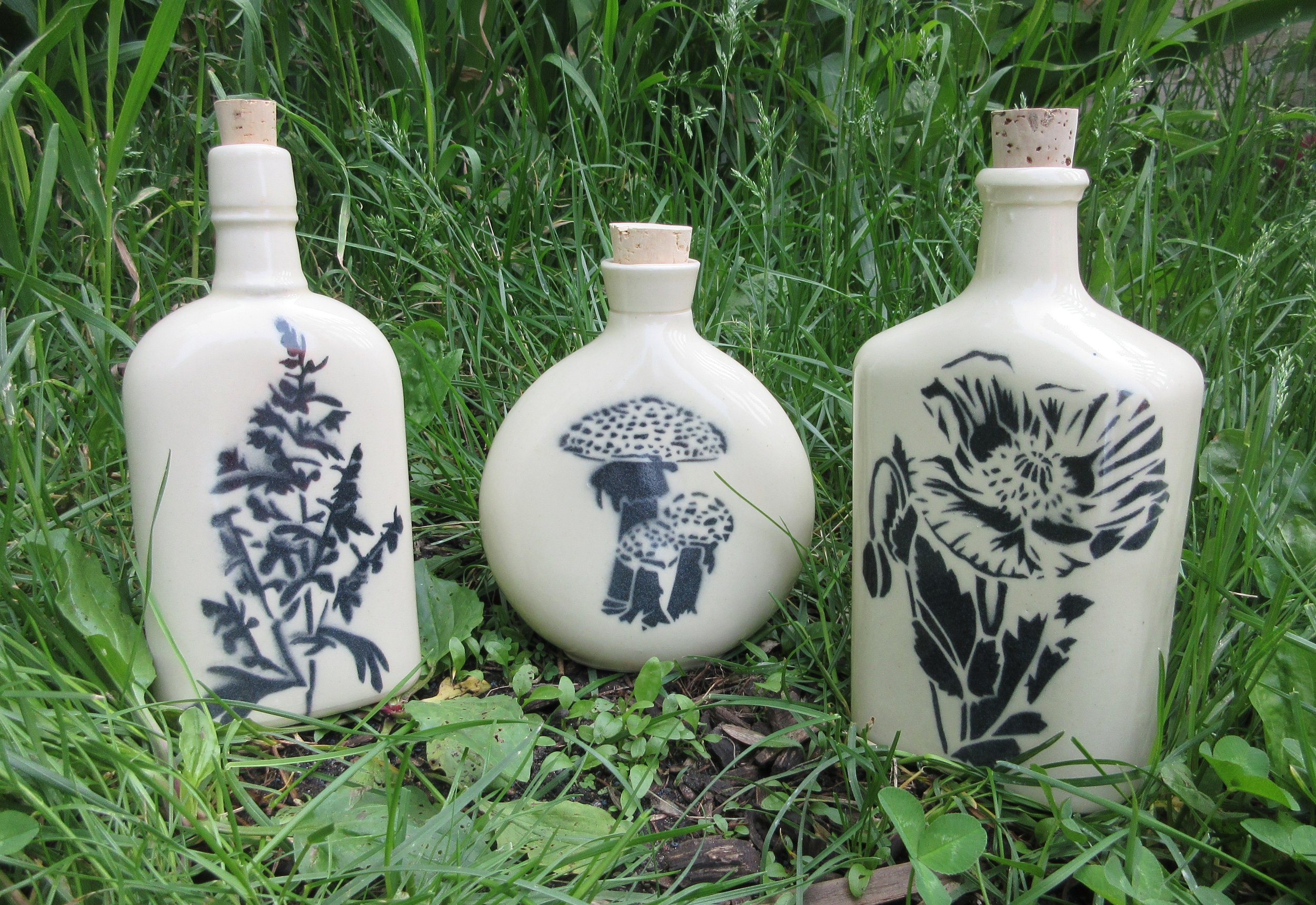Baneful Herb stencils on slipcast ceramic Witch Bottles: Mugwort, Amanita and Poppy. 10 altogether, below are Belladonna, Blue Lotus, Datura, Hemlock, Henbane, Mandrake and Wolfbane. Witch bottles migrated with witches of Celtic descent to the East coast and Appalachia in the 1600's, beginning as countermagical devices used to protect against other witchcraft and conjure.