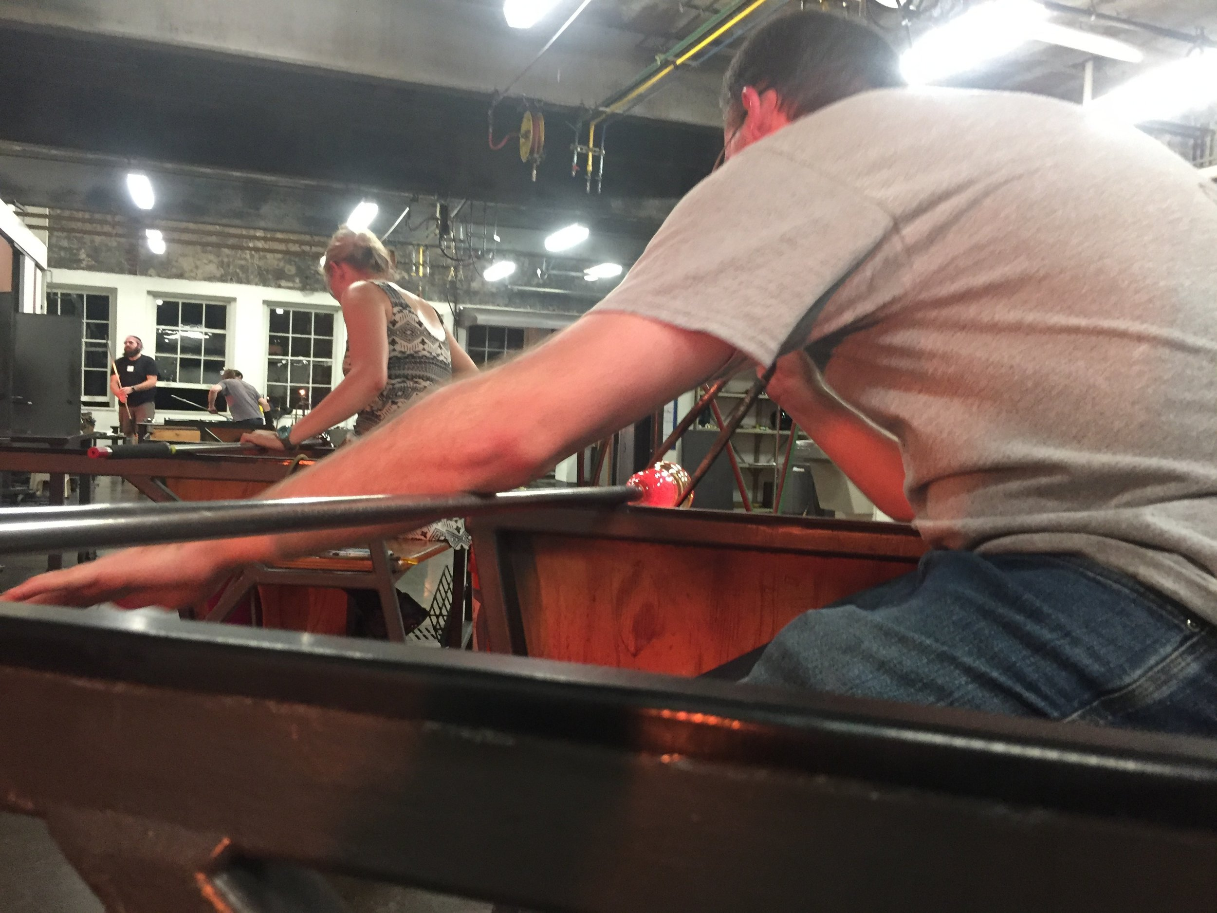 Assisting partner in glass blowing