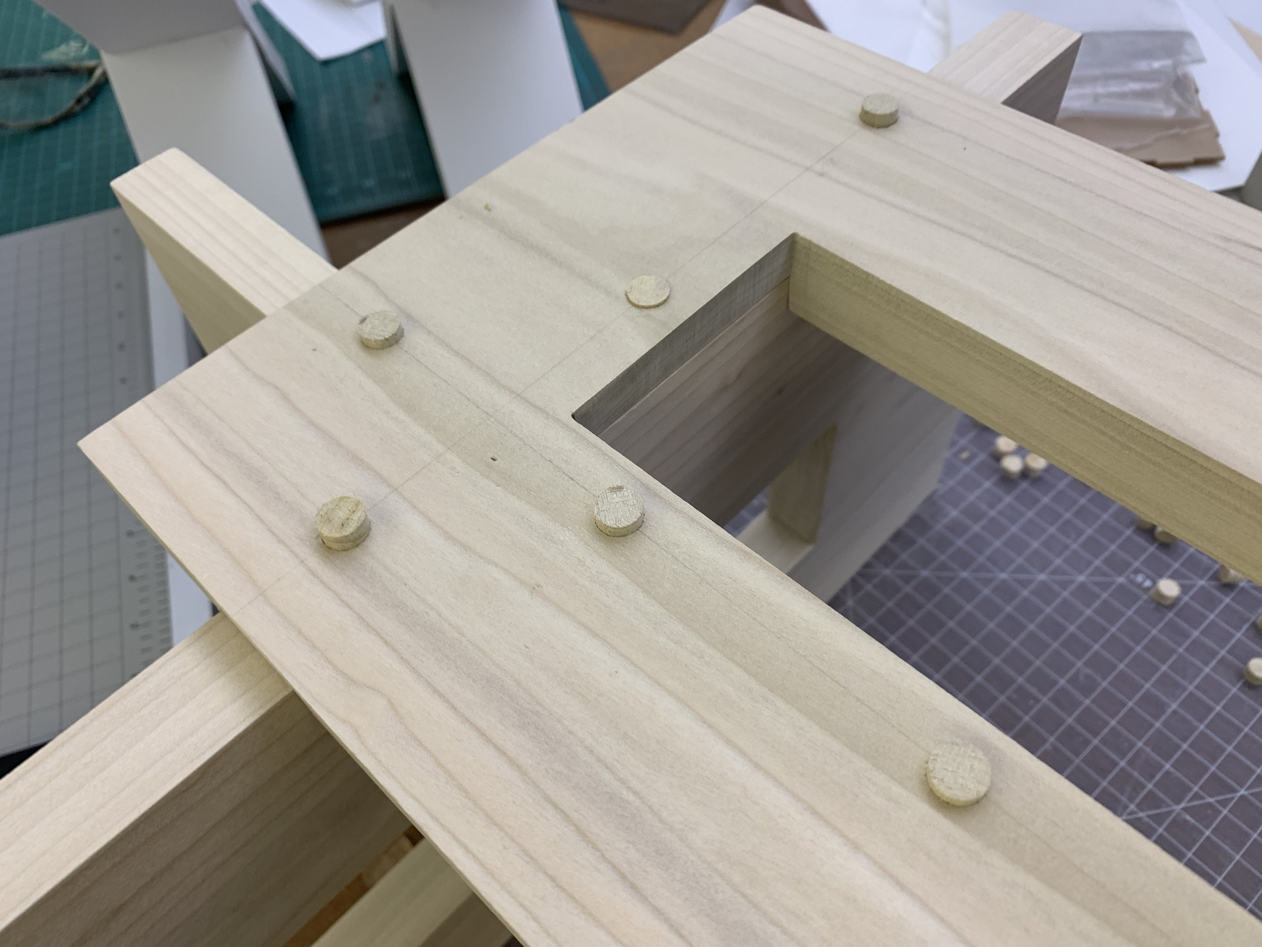 Assembled geoform with wooden plugs setting in wood glue before chiseling