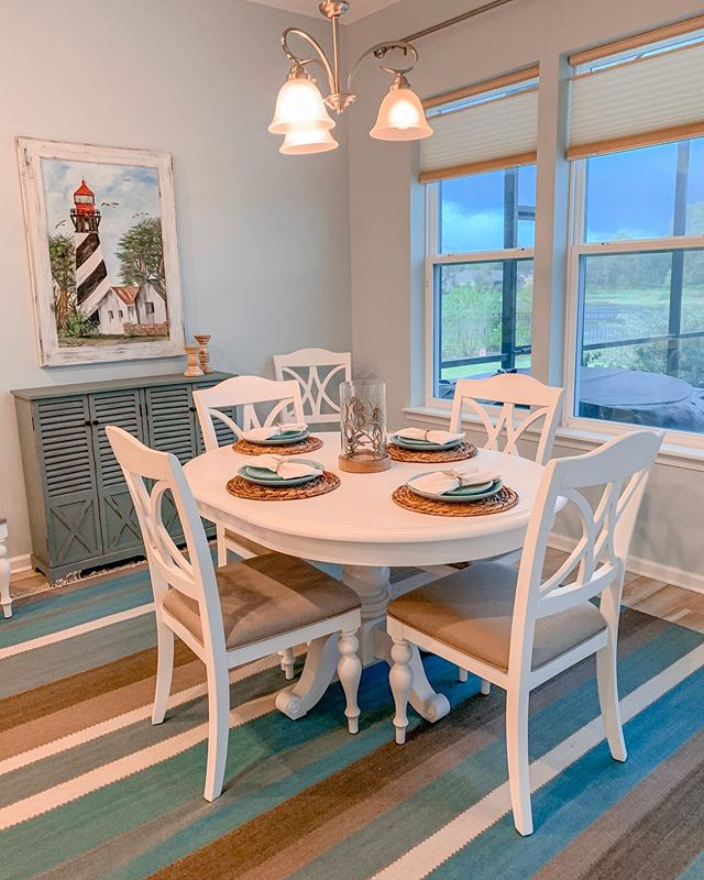 "It's still a work in progress but my Client's new dining room is coming along nicely! When my client purchased this home, the dining room was PINK. VERY PINK. We chose ""Summer Showers"" by @benjaminmoore to replace the pink walls, added a custom Local Art piece and new furniture 😍. #interiorsbykaitlyn #interiordesign #coastalinteriordesign #staugustinebeach #staugustine"