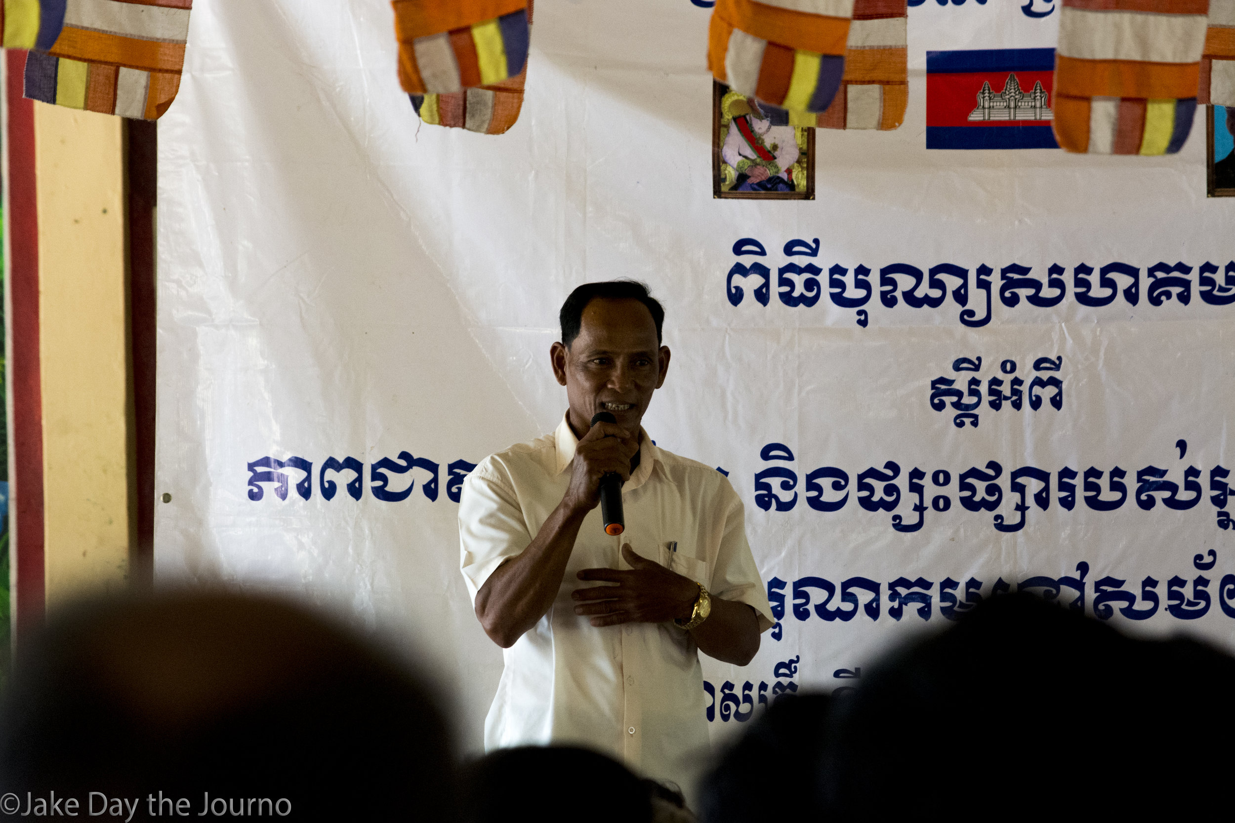 Commune Chief Skonn Sakin gives a speech during a testimonial ceremony organised by the Transcultural Psychosocial Organisation for the 'Healing and Reconciliation for Victims of Torture of Khmer Rouge Trauma' program at Ta Ann village, Ta Ann commune, Kralanh district, Siem Reap province on 18/01/18 by Jake Day.