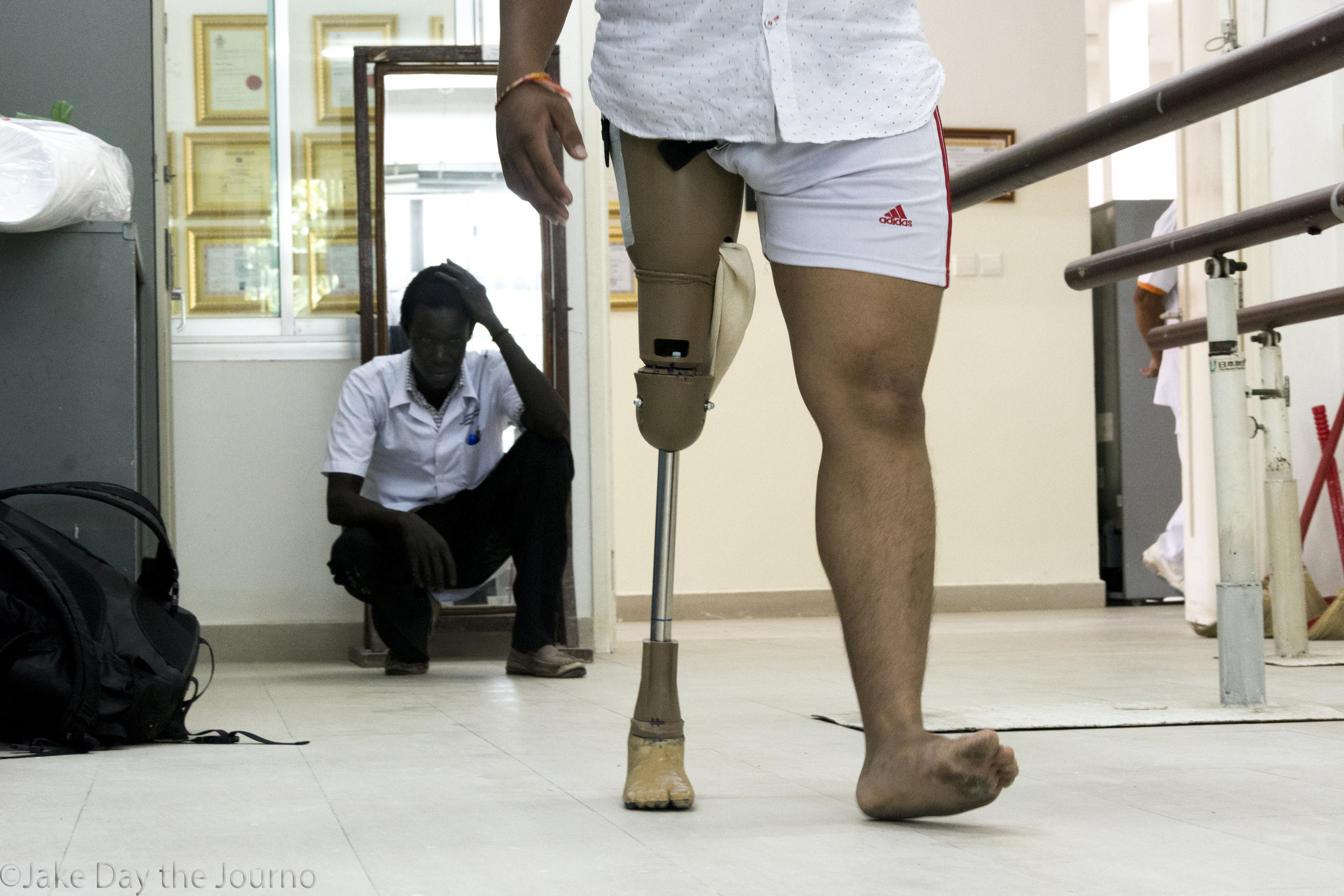 Second year student Tombura Joseph Kenyi, 23, watches Mean Teit Sha, 21, during gait testing at the Exceed Cambodian School of Prosthetics and Orthotics on 15/01/18 by Jake Day. Mr Sha is wearing a prosthetic made by Mr Kenyi. The quality of the prosthetic is to be assessed during examinations the following day.