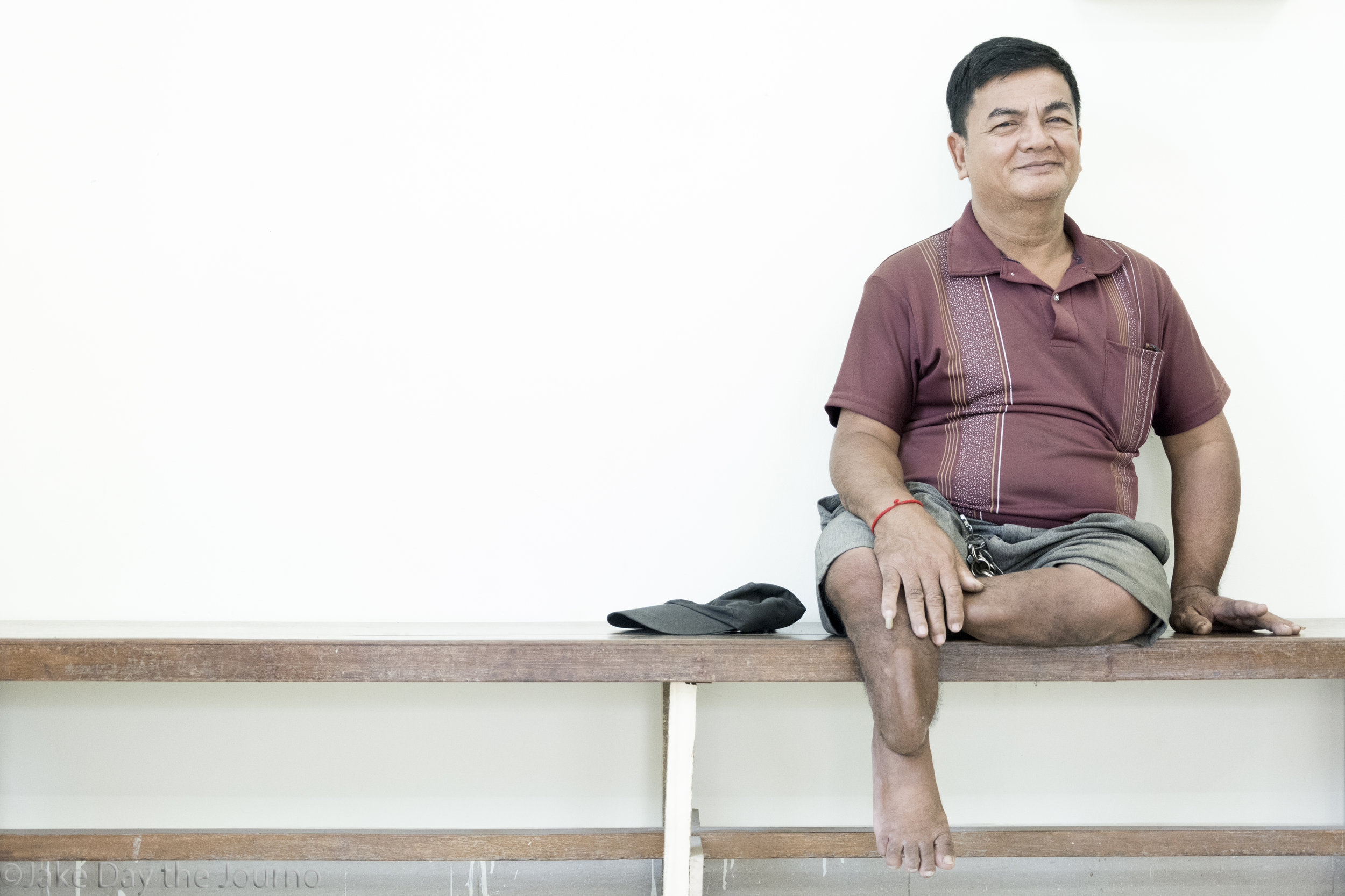 Pech Lun has suffered from osteoporosis since birth. He waits to be seen by a physician at the Exceed Cambodian School of Prosthetics and Orthotics on 15/01/18 by Jake Day.