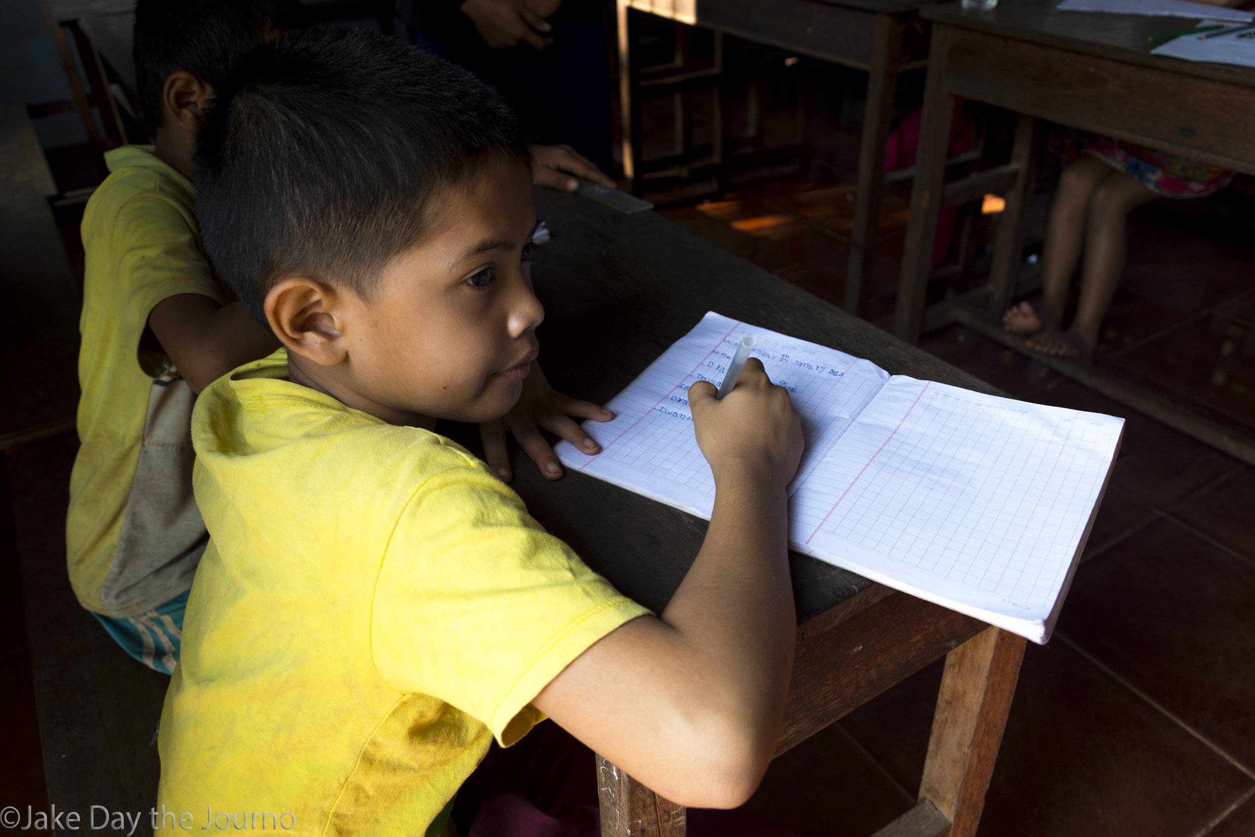 Beanglom, 9, practices English at Savong's School, Don Teav Village, on 24/01/18 by Jake Day.