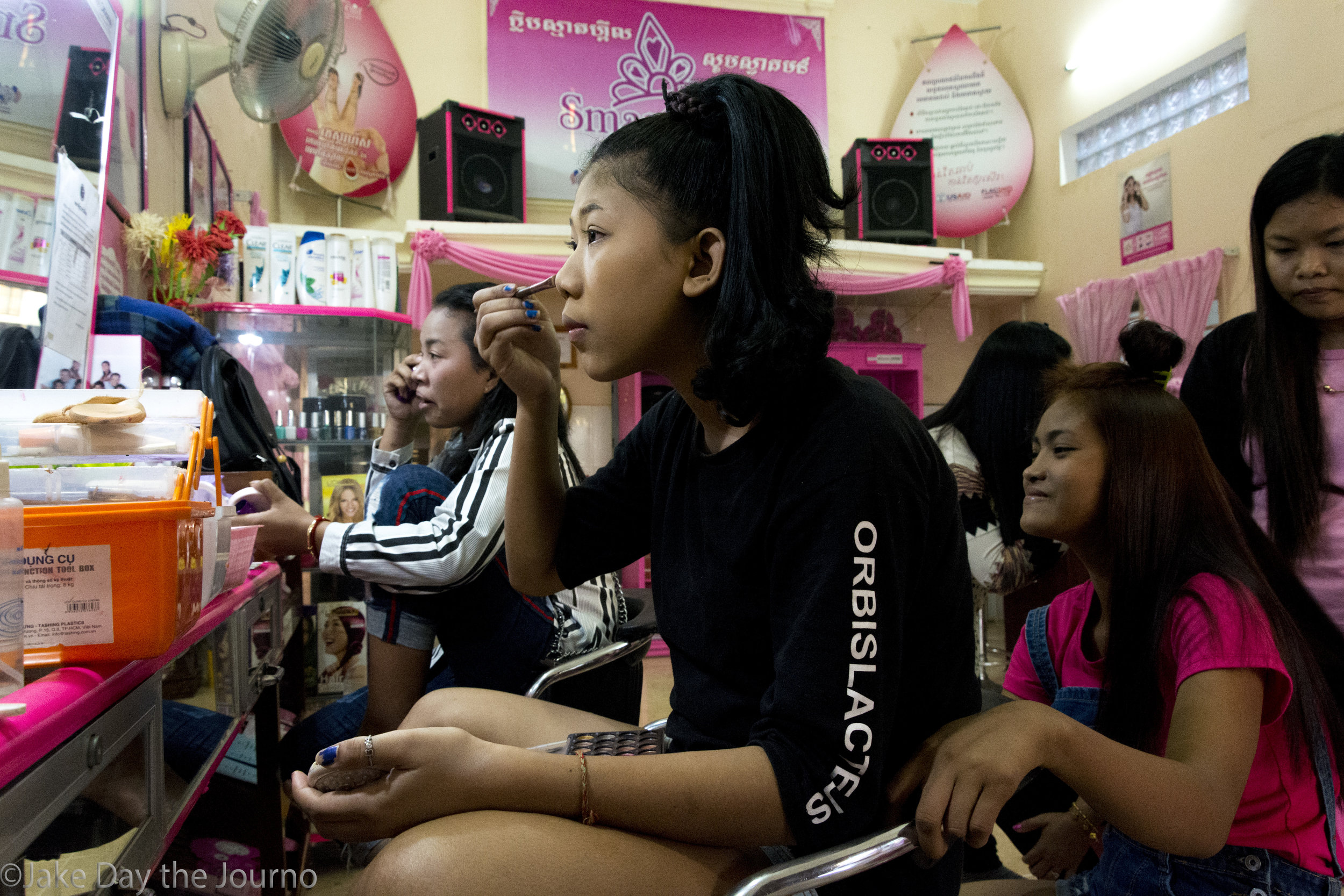 Entertainment Workers apply makeup at the SMARTgirl club in Siem Reap on 22/01/18 by Jake Day. The club begins to fill with Entertainment Workers late in the afternoon. After doing their makeup and hair they will head out to work night shifts at various establishments.