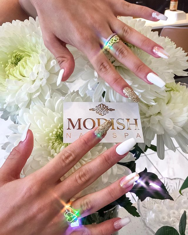 ✨👑 Nails fit for a queen! — If you like it then you should put some ~bling~ on it. Shimmer and shine with this stunning statement look! — #ModishNailSpa #Bling #NailsofInstagram #DipPowderNails