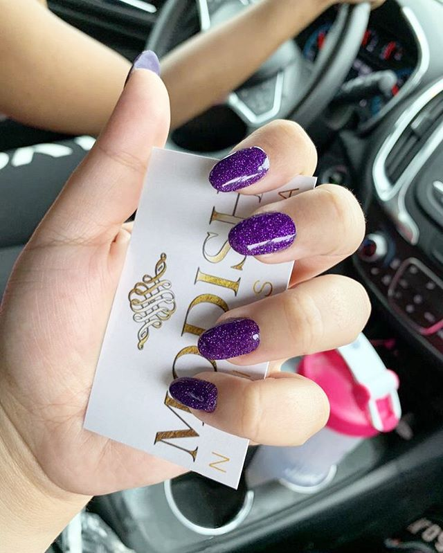 ✨🔮 A deep, shimmery purple is sure to add that *POP* to your nails! Love this daring, bold look. . #ModishNailSpa #dippowdernails #designnails #glitternails