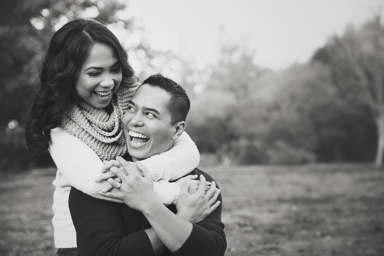 Happy couple during a photoshoot with Sacramento Photographer Mayumi Acosta.jpg